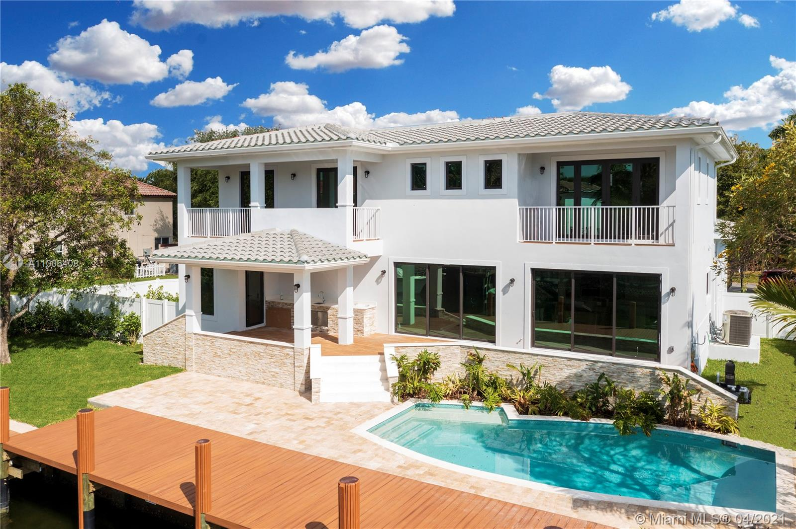 Welcome to this beautifully designed Hollywood home located in an exclusive area of South Lake on a 100' waterfront lot with direct ocean access seconds away from the Intracoastal. The luxurious new construction spans a total of 5,000 Sq Ft, with 3,660 Sq Ft of living area, 5 bedrooms, 6.5 bathrooms on a 12,000 Sq Ft lot with sparkling pool and a new 100' dock. High quality construction and top of the line designer finishes, Florense kitchen and baths, Miele appliances, wood floors [etc] - all add to an exclusive appeal that makes this magnificent property stand out from the rest. The 2-car garage is complemented by a carport and a large driveway that can fit up to 4 cars. Waterfront new construction priced at $700 per Sq Ft is a rare find.