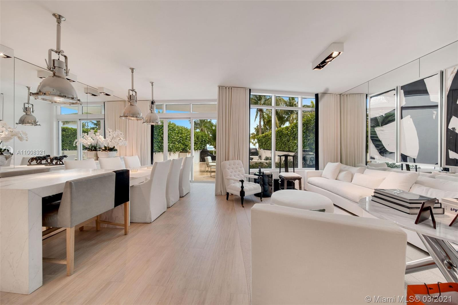 A rare and significant offering at Continuum North Tower. This unique turn-key townhouse features front row unobstructed ocean views from every level with 4 beds, 4 full bath, large entertainment levels, private hot tub. Designed with meticulous attention to detail by Michael Dawkins. An exclusive upscale beachfront resort with 12 acres, 2 lagoon pools, beach towel and food service, a state-of-the-art gym and spa, restaurant, 3 tennis courts and pro-shop, valet parking, security and concierge.