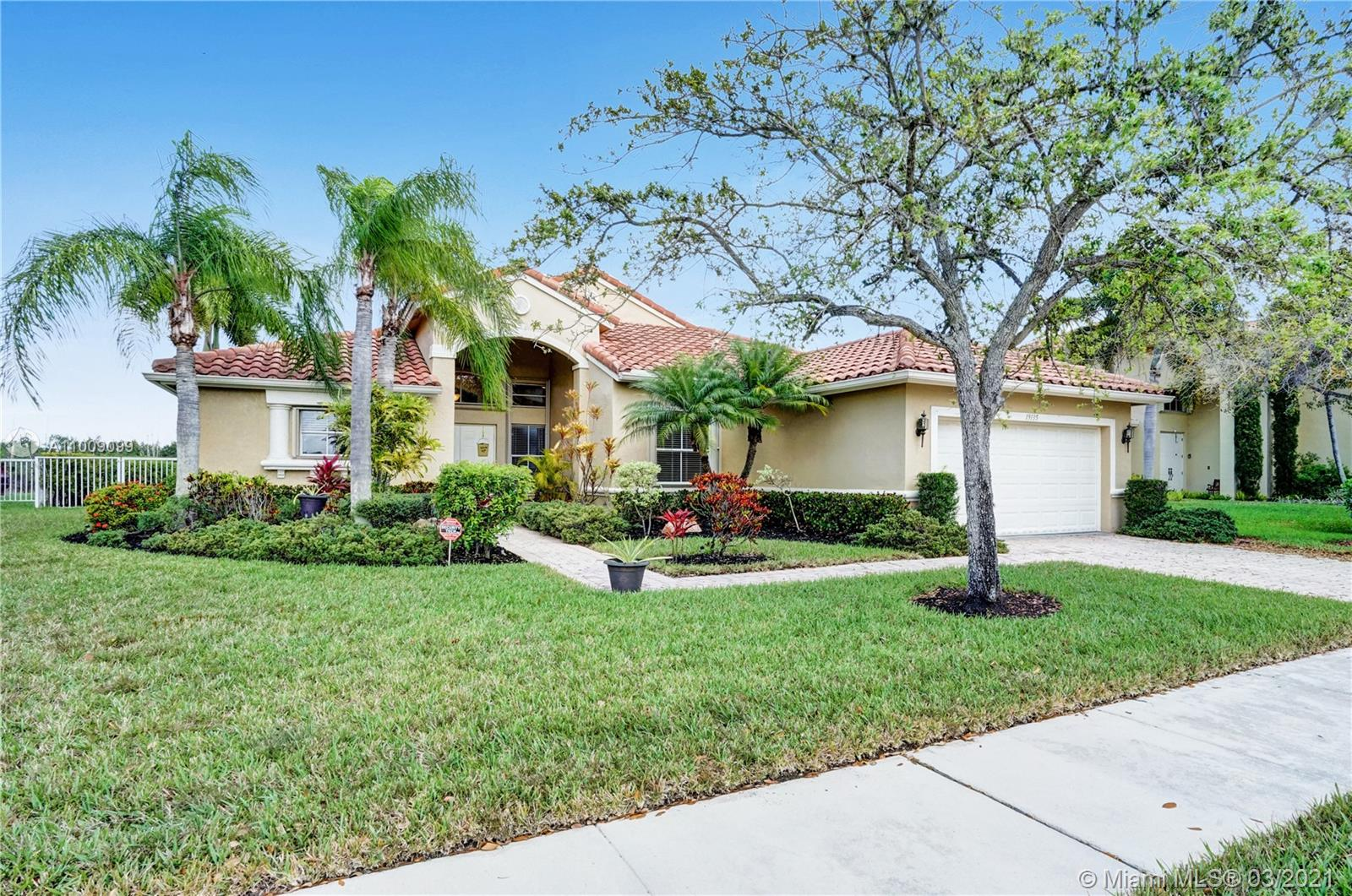 Come live in one of the most sought-after gated communities in Pembroke Pines, Encantada. This beautifully remodeled home features 4bed/2 bath, upgraded kitchen, including granite countertops and Stainless Steel appliances. The large master bedroom features two walk-in closets, renovated bathroom, including quartz countertops, dual sinks and frameless showers doors. Guest bedrooms/bath upgraded with new flooring and quartz countertops. The property has New accordion shutters and a tankless water heater. Come relax in the covered patio and serene views of the lake. No neighbors in the back for extra privacy. This home sits on an oversized lot, plenty of space for a pool. Located near the best A rated schools. Don't miss the opportunity to live in this beautiful family oriented community.