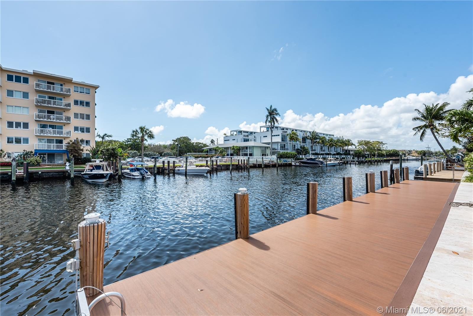 Tenant in place paying $6,700 per month until April 2022. Pompano Beach gem is the perfect dream home for yachters and people who enjoy outdoors. Prime 3/2 waterfront pool home on cul-du-sac w/ ideal setting for entertaining inside or out. Spacious pool deck, hot tub and oversized screened-in patio with shutters (can be easily enclosed for added living area). Baths are recently renovated and electrical panel is new. Brand new dock stretches 80' along water to moor your yacht on widest canal. Only 4 houses and 320' from the Intracoastal w/ no fixed bridges so watch the boat parade. Master bedroom and kitchen overlook the pool and water w/ impact glass. Gas cooking available. 5 minute walk or bike ride to the beach. Enjoy cafes/restaurants at Lauderdale-by-the-Beach w/ live music nightly.
