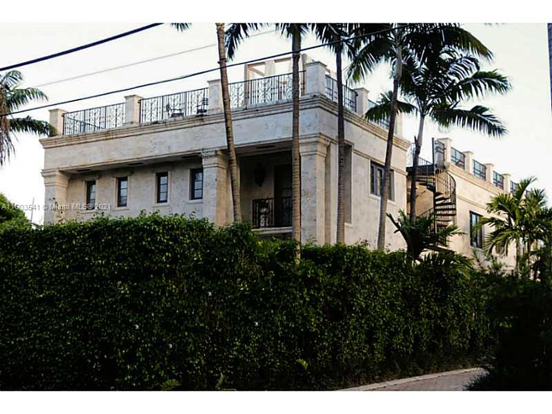 Two Story Italian inspired masterpiece. It is located on a private and guard gated Island in Miami Beach, Sunset Island IV.  This house has 4 bedroom, 1,000 Sq Ft the Master Suite with amazing view, Billiard room, gym, secured parking for 5 vehicle . The roof deck with summer kitchen, views of Biscayne Bay, Downton Miami & Islands. New deck, (60ft on water). Walking distance to Lincoln Road and Sunset Harbor shops and restaurants. 15 minutes to airport. Live in an Island, very quiet in the middle of South Beach.
