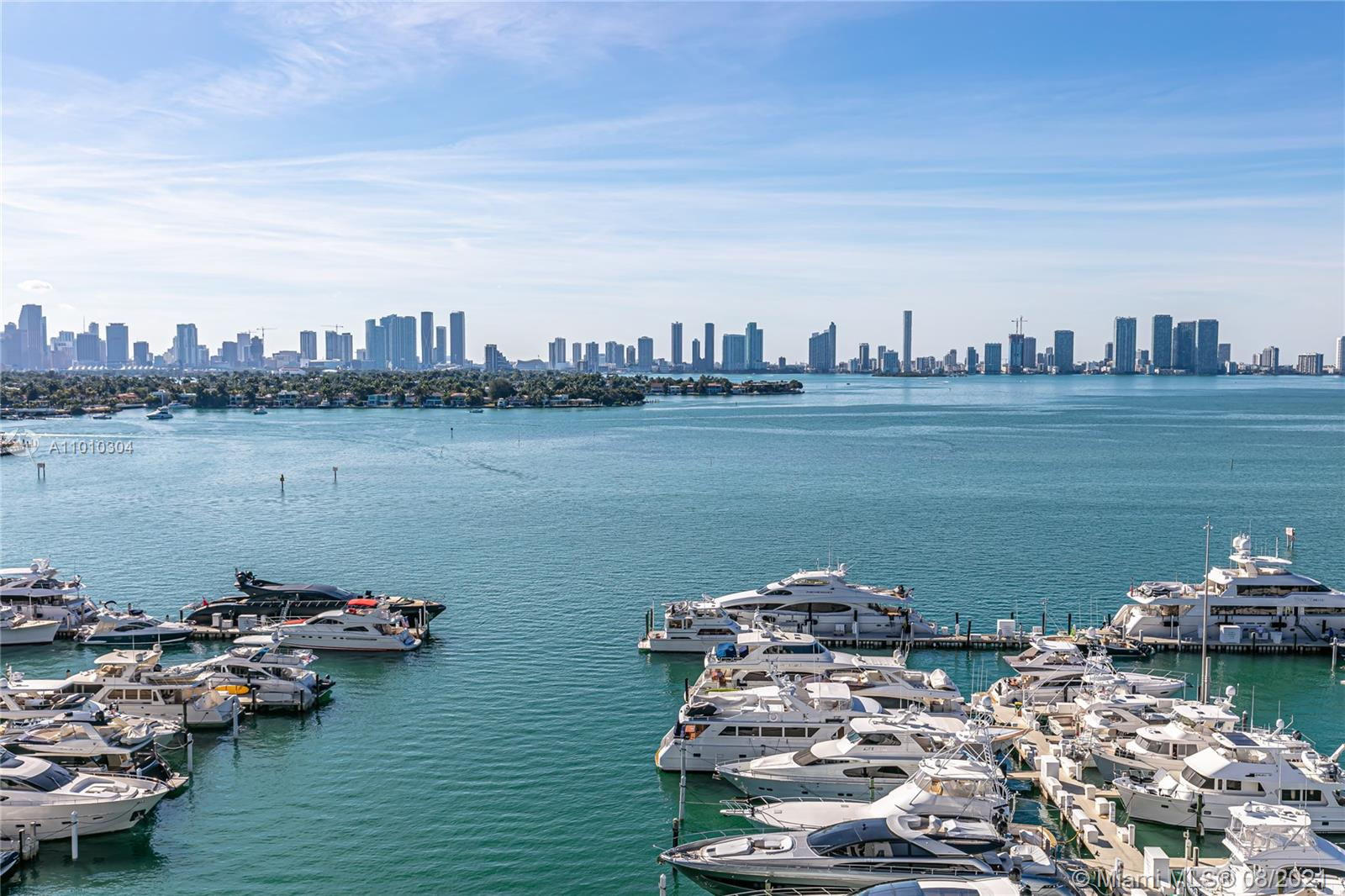 Rarely available corner unit in Sunset Harbour North featuring spectacular unobstructed views of Biscayne Bay, Sunset Islands, and Miami's skyline. Completely remodeled residence featuring 3 balconies, an intimate custom-designed media room, and 2 deeded parking spaces. Interior highlights include split floorplan, large format creamy white porcelain floors, custom kitchen, large laundry room, top of the line plumbing fixtures and appliances, NEST smart thermostats and hurricane impact sliding doors and windows. Full service building located in one of the most exclusive neighborhoods in Miami Beach, home to the prestigious Sunset Harbour Marina and an eclectic mix of shopping and dining options. Showing by appointment only with 24hrs minimum notice. Call listing agent.