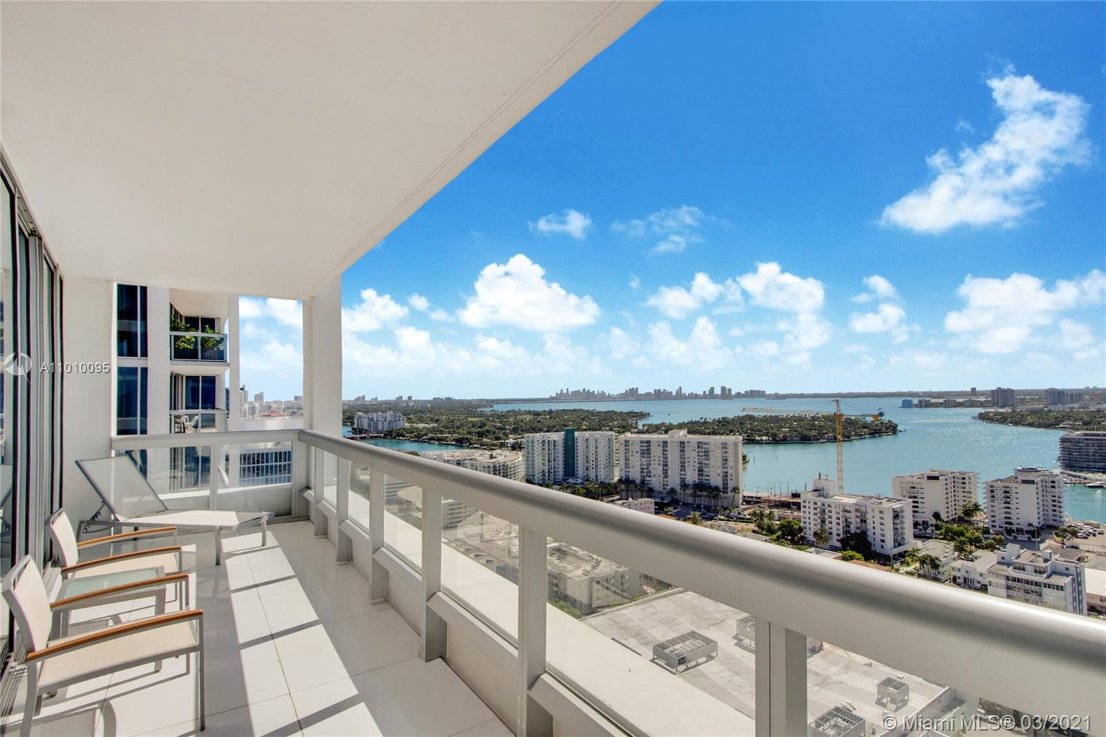 Sweeping panoramic bay and city skyline views from this beautiful 2 BD / 2 BA corner unit in prestigious North Tower at the world-renowned Carillon Wellness Resort. Very bright, turn key unit with spacious balcony, high end kitchen, marble floors, spacious bathroom, floor-to-ceiling impact windows, pool facing balcony and all fixtures/finishes top of the line. Deluxe amenities, 70,000 sq ft Spa/Fitness center, 40+ Fitness Classes daily, 4 swimming pools, full service Concierge, farm to table restaurant, Juice Bar, boutique, 24hr security, valet, wellness staff, full Beach Service and much more.