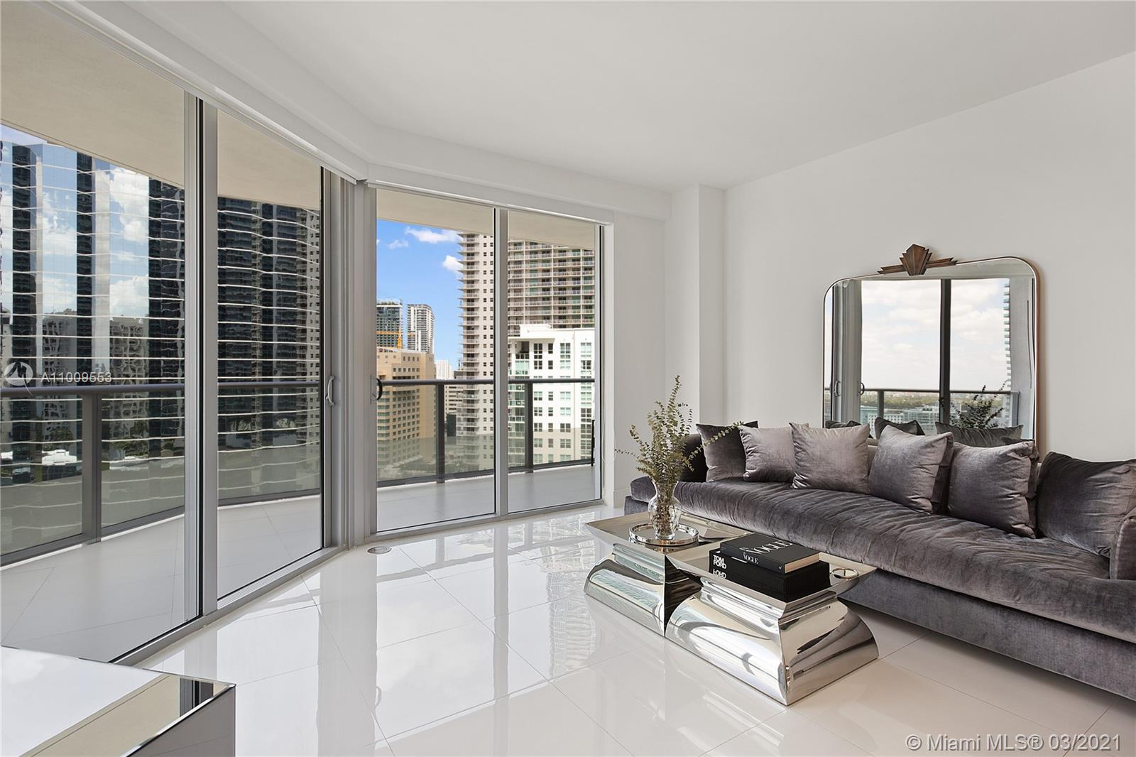 STUNNING TURNKEY 22ND FLOOR 2 BED/2 BATH CORNER CONDO AT THE FIVE STAR AMENITY BRICKELLHOUSE.  THIS GORGEOUS CONDO WITH FOREVER SUNSET AND BALCONY WATER VIEWS HAS BEEN METICULOUSLY FURNISHED AND UPDATED WITH DESIGNER CUSTOM FURNITURE, OTHER HIGH END DECOR WITH NO DETAIL OVERLOOKED.  EXTRAS INCLUDE BUT NOT LIMITED TO MULTIPLE RECESSED LIGHTING, CUSTOM BACKSPLASH, UPGRADED W/D, CUSTOM CLOSET, NEW KICKPLATES, DECORATOR PAINT.   BRICKELLHOUSE OFFERS ROOFTOP DECK AND POOL, GYM, FITNESS SPA, CONCIERGE SERVICE, LAP POOL, POOLSIDE CABANAS, SAUNA, STEAM ROOM.  SEPARATE BUILING GARAGE PARKING.  COMPLETELY READY TO MOVE IN INCLUDING FURNITURE, DISHES, LINENS!