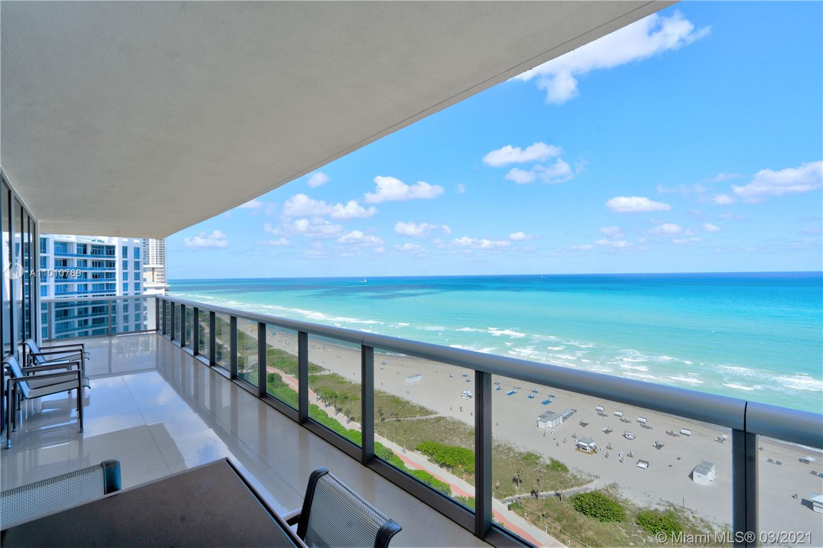 """This is the one you have been waiting for! The 01 line is the most desired in the building offering a direct panoramic ocean front view. The 19th floor is also """"The perfect height"""" were you can enjoy beautiful Ocean and city skyline views from a HUGE wraparound terrace with over 700 sq. ft. A truly Multi Million dollar view! This condo offers an open design kitchen with top of the line Thermador appliances including a built in espresso machine. Two bedrooms, two and one half bathrooms conveniently located near South Beach and Bal Harbor. This boutique stile building is very service oriented with valet parking, concierge, security, pool and beach service and onsite management. Special assessment on this unit is paid in full, the new owner can enjoy of the many building upgrades just made!"""