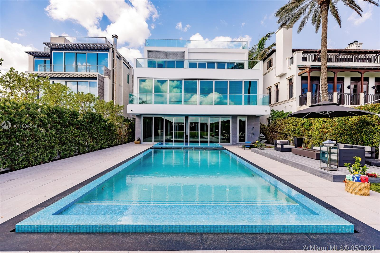 Enter to this exclusive home in the white sandy beaches of the Atlantic Ocean of Miami. The exclusive community of Altos Del Mar is centrally located surrounded by restaurants, minutes from the exclusive Bal Harbour Shops. This 3-stories+terrace offers the celebrity lifestyle, full amenities Home. Attention to the details, newly built 2017. 1st floor features home theater, bar, office, family room, floor-ceiling sliding glass doors opening to a summer kitchen, heated pool, jacuzzi, cabana, and large manicured fenced backyard with its own Basketball court. 2nd level grand entertaining room w/ fireplace, custom-built kitchen, wine cellar, walls of glass onto large terrace. A pathway leads you to the four bedrooms suite. 3rd floor owner master suite w/ a private terrace overlooking the ocean.