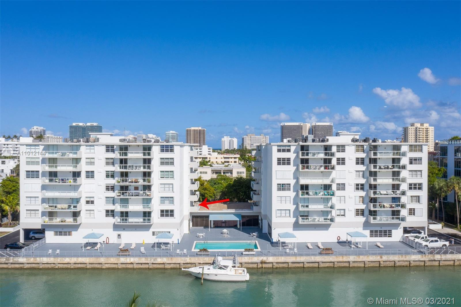 Enjoy spectacular sunsets and water views from the terrace of this oversized 2 beds 2.5 baths condo with nearly 1500 sq ft of living space. This unit comes with washer and dryer, one covered parking and private storage. Amenities include canal front pool deck, 24 hour concierge, heated pool, exercise room and dockage. Building has undergone gorgeous remodeling which includes glass balconies and updated hallways. Located in the heart of Bay Harbor within walking distance to top rated schools, fine dining, beaches and Bal Harbor Shops.