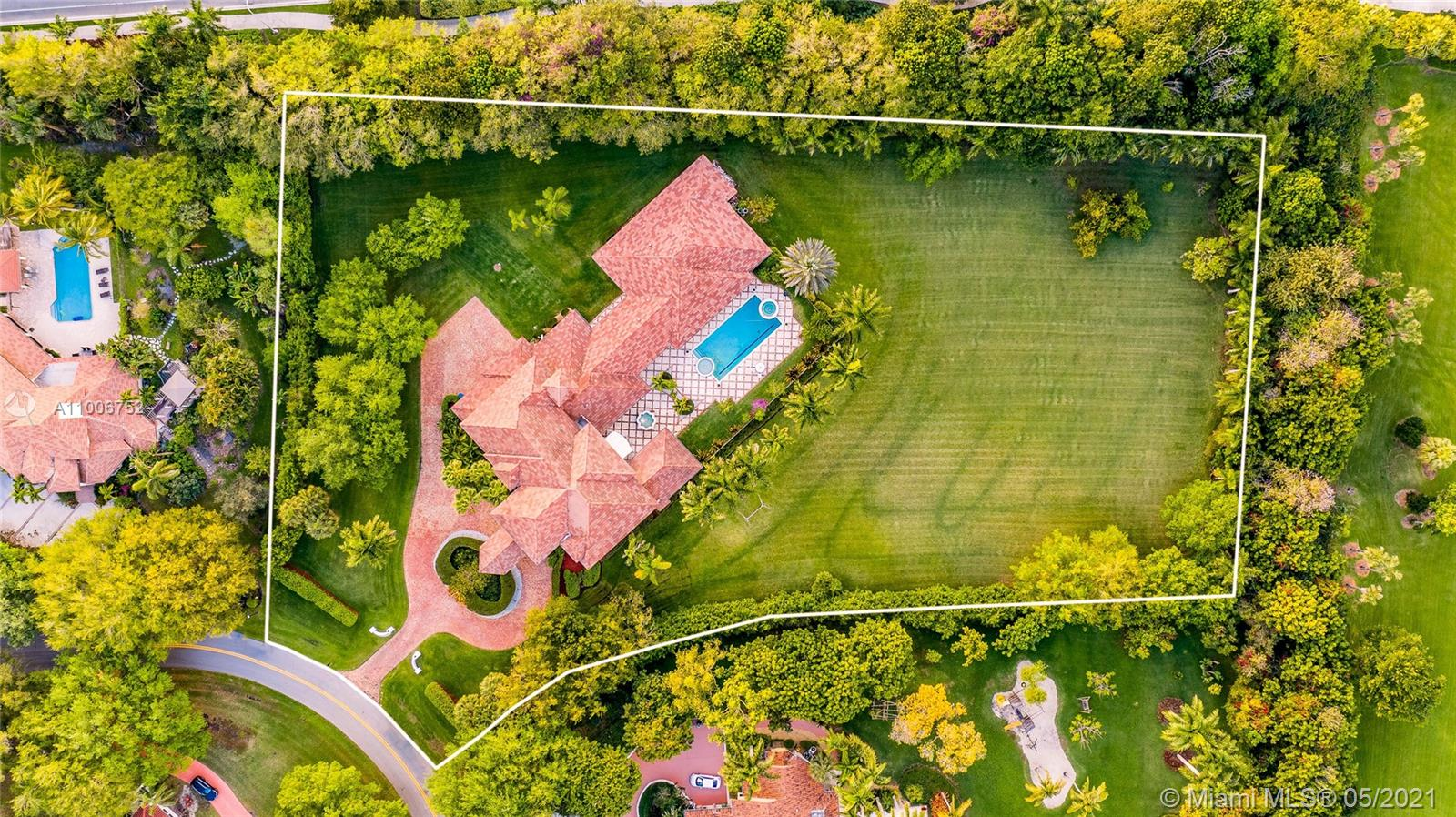 La Estancia - a signature estate on 3.6 ACRES in prestigious Windmill Ranch Estates! An opportunity like this is rare. Features a connected guest house with full kitchen, theatre, game room, gym and in-law quarter all on 1st level. Enveloped in privacy, fenced and offers your own sports field with huge grassy area. There is no need to leave home when you have such wonderful space and amenities!  Big swimming pool with in-pool spa.  Timeless elegance affords you to move right in or update to your desired tastes. Floor plan and dimensions are as you would design a new house today. Expansive kitchen opens to family room and covered poolside patio with summer kitchen. Wet bar in living room makes you want to linger with family and friends. Stunning porte cocher entry and Chicago brick driveway