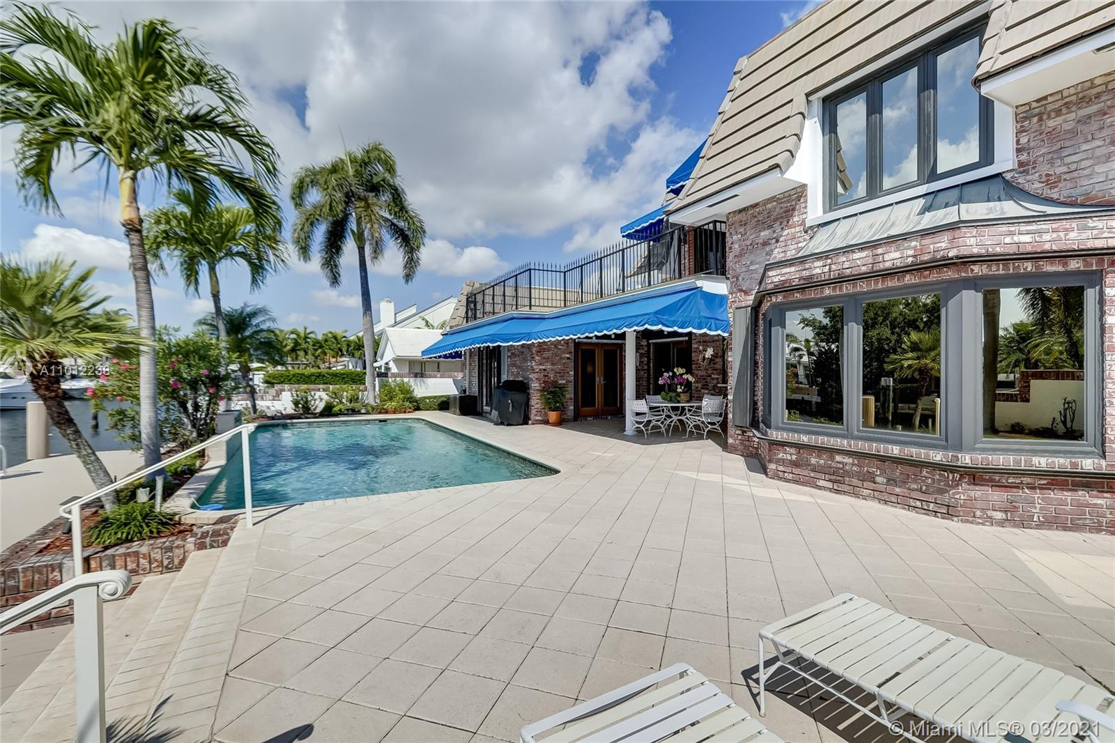 A boater's dream come true, this elegant oasis in coveted Coral Ridge enjoys the luxury of its very own private dock along with an array of tantalizing bay, canal, and Intracoastal views. Spanning two gracious levels with a versatile layout, the home is idyllically situated on a quiet cul-de-sac just a stone's throw from the tranquil Intracoastal and mere minutes from the ocean. The perfect vacation home, primary residence, or income property, this supremely serene refuge spares no details and showcases dramatic light-filled living spaces, sumptuous hardwood floors, a chef-inspired kitchen, spa-like baths, an invigorating pool, manicured gardens, and a suite of tasteful finishes throughout.