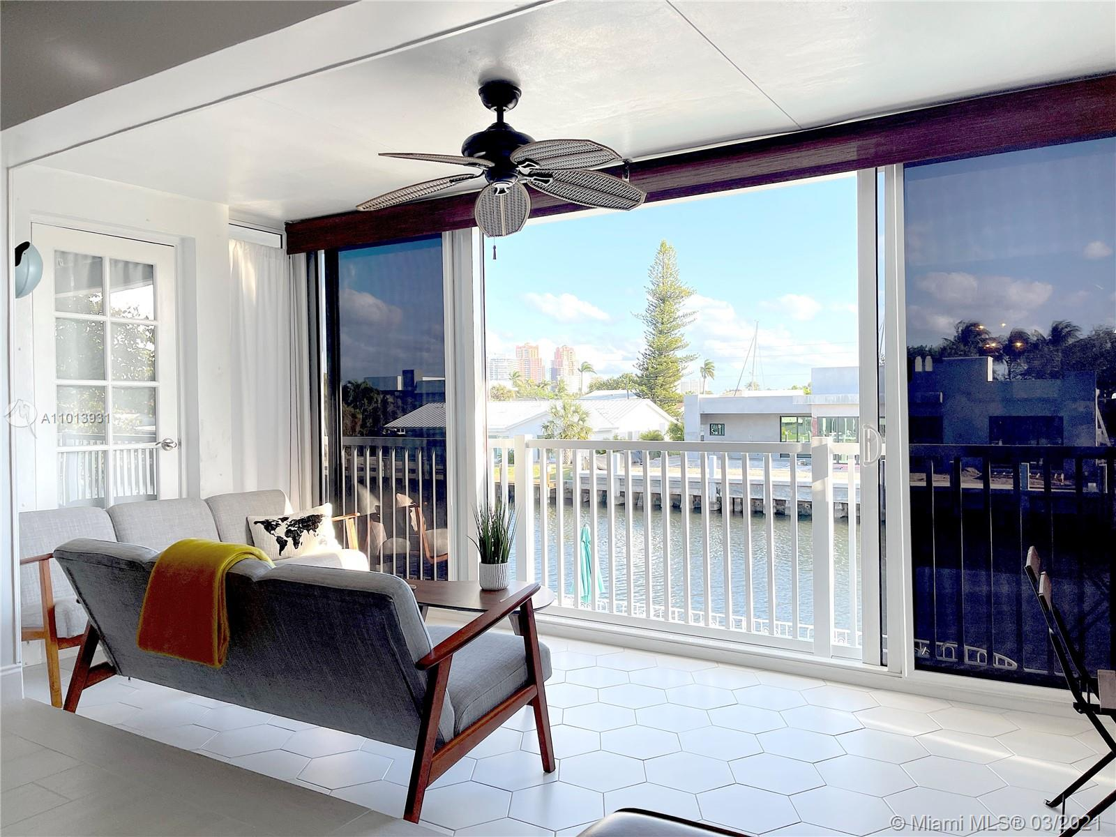 AMAZING WATERFRONT VIEW! RENOVATED and READY TO MOVE IN! This is the only unit in the building with its own Washer and Dryer! This very beautiful unit is now available for purchase. New Floors, New Bathrooms, New Painted Walls, New Custom Bedroom Wall. This modern style unit is overlooking a beautiful waterfront view to the south. Multi million dollar properties across the water. The enclosed balcony has been fully opened to the living room with new impact all glass doors from ceiling to floor. Living room is super spacious and filled with light all day. Master Bedroom also overlooks the water view. New Modern Tile has been installed in the entire unit. Granite countertops in kitchen. All New Renovated Master Bathroom with Modern Style! (Real SQFT 1100)