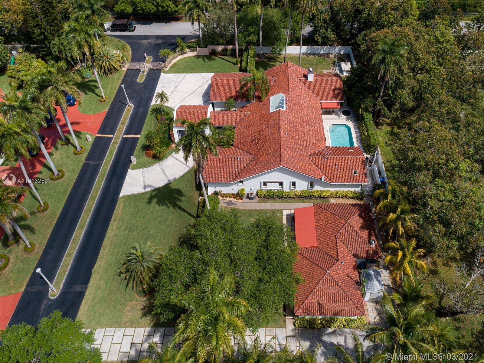Magnificent private oasis located in a gated community just off Sunset & South Miami area. This gorgeous home offers a detached 1bedrm/1bathrm guest house, main house features 4 bedrms & 4/1 bathrms with large living areas for entertaining family & friends, including a formal living room with views of the formal dining room & sitting area. Gourmet chef's kitchen with cozy breakfast area booth with bow windows. Enjoy an expansive family room with fireplace, & wet bar. Master Suite offers large space with walk in closets, spa like bath, jacuzzi tub, double vanities, & separate shower. Discover an outdoor retreat with large pool & spa, covered terrace & summer kitchen. Additional Features: guest house includes a sauna room private entrance & driveway w/ ample parking, 2 Car gar & laundry rm.