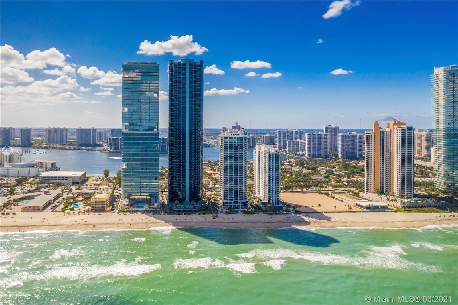 """This oceanfront unit in the prominent """"05"""" line at the Porsche Design Tower is a collector's dream. The 20th-floor unit with an unrivaled car elevator and windowed two-car garage is a 3-bedroom, 4.5-bathroom move-in-ready home boasting Volaka marble flooring, Poggenpohl kitchen with SS Miele appliances, and bathrooms with Dornbracht fixtures and Toto Neorest toilets. Additional details: heated balcony pool, floor to ceiling impact windows, separate laundry and garbage room with service bathroom, and living room fireplace. Building amenities include: private restaurant and bar, billiards, movie theater, golf and auto racing simulators, state-of-the-art gym and spa with steam, sauna, ice therapy, yoga and massage rooms. Hair salon offers manicure and pedicure services, upon request."""