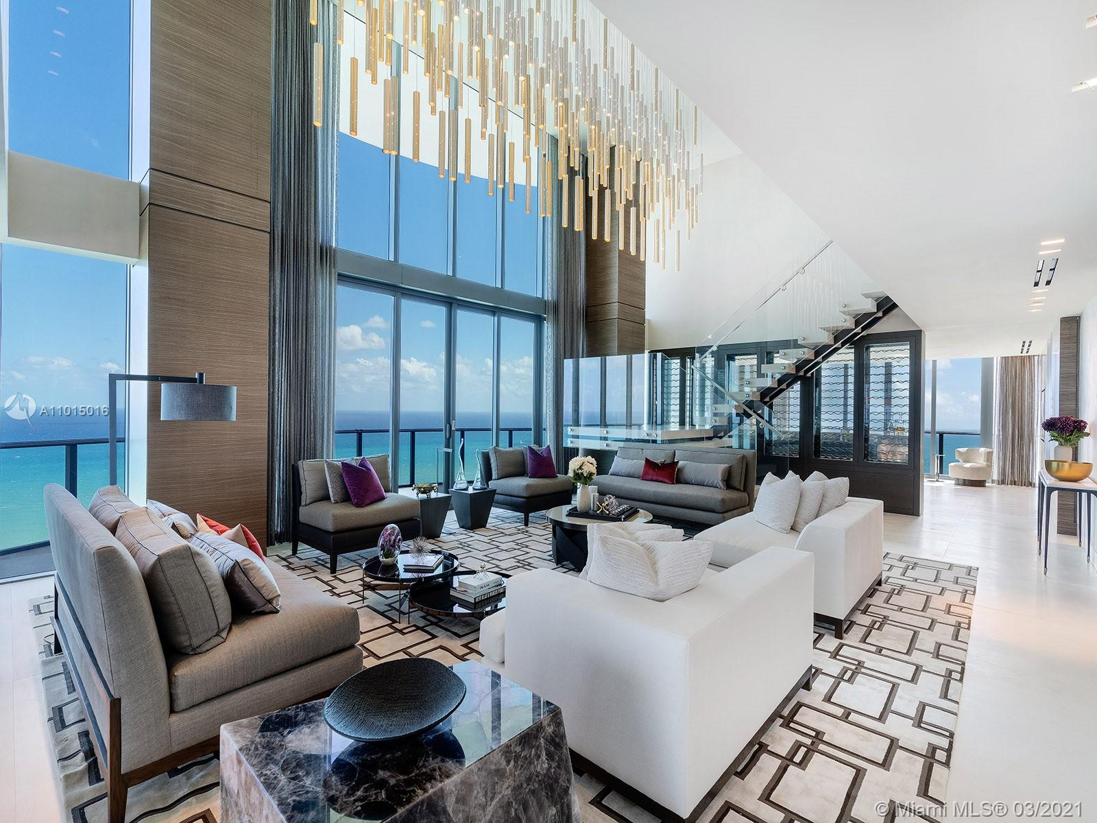 The Penthouse at Regalia Sunny Isles Beach, which spans three floors at a sweeping 16,805 square feet, feels like a private house in the sky, with all the services and amenities of an ultra-luxury oceanfront condominium. The 6-bedroom residence features a variety of living and entertaining areas, from the grand, double-height living room, to the quartz and bronze cocktail bar, game room, theater, and rooftop pool with summer kitchen. The private areas are no less unique, including the massive master bathroom with connecting private spa equipped with sauna and steam rooms, and the guest living room. A private elevator links all three floors. Outside, undulating terraces wrap a full uninterrupted 360 degrees on the first and third levels, with a partial terrace on the second.
