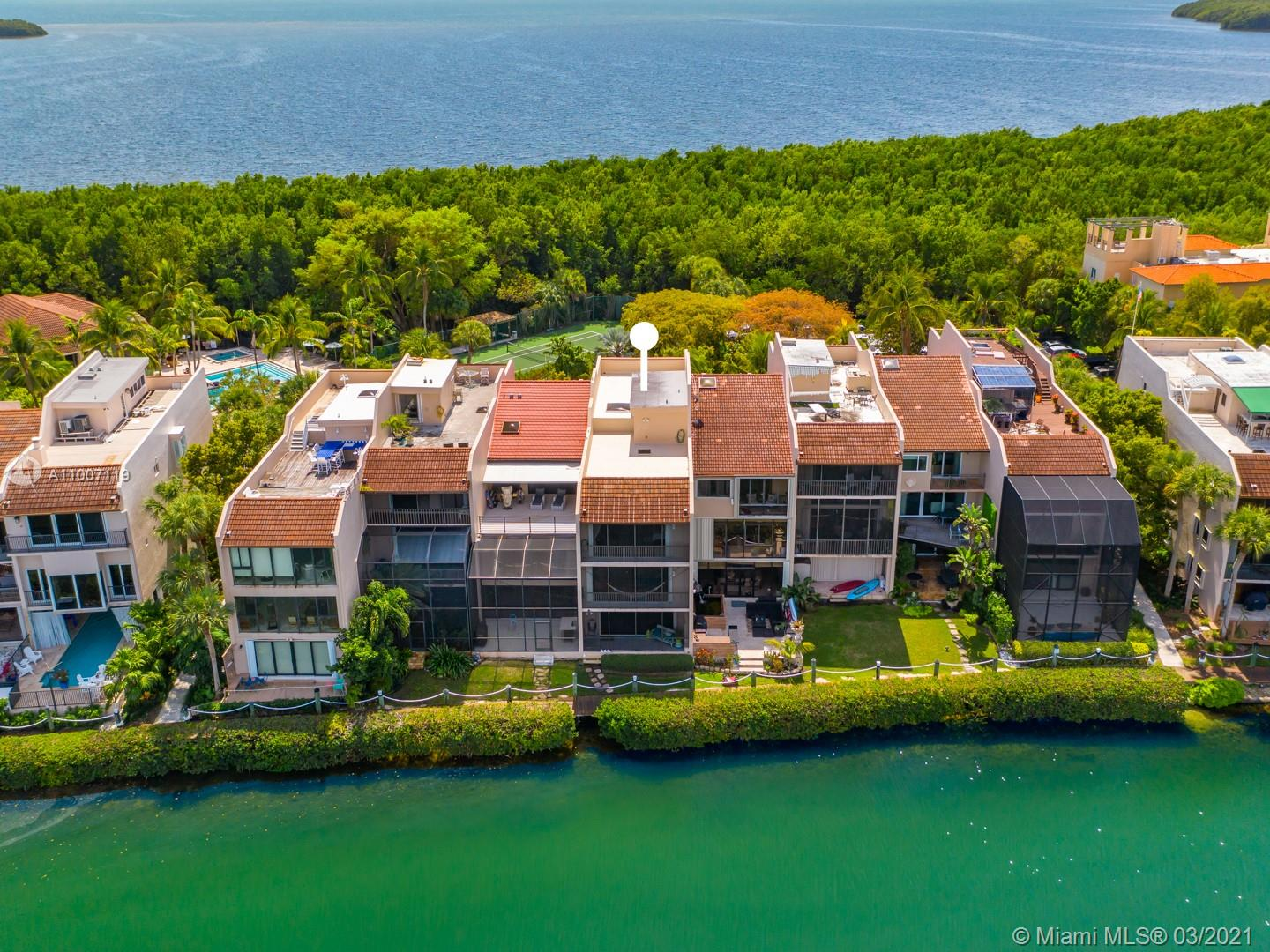 Live a true island lifestyle in one of the area's hidden gems, Royal Harbour. Kiteboard, paddleboard, hop on your boat, play tennis or swim w/o leaving the neighborhood! This XL waterfront townhome w/ loads of storage has an open flr plan w/ 3 interior levels + rooftop deck. 2nd-flr main living area incl updated open kitchen/family room - prepare dinner while watching manatee! Spacious master + 2 addl bdrms on 3rd flr with 1st flr bdrm/living area + full bath perfect for guests, a teen &/or workspace.  Community incl securely gated entrance w/ on-site guard & manager, beach area w/ Chickee hut & vb court, clubhouse, fitness room, pool/hot tub, 2 tennis courts, boardwalk, & marina. +/- 50' BOAT SLIP FOR SALE SEPARATELY ($290,000).  Be sure to see virtual tour. Listing agent is an owner.