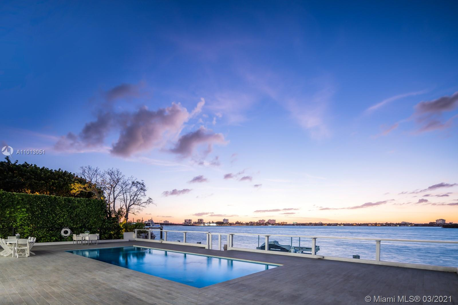 Welcome to Bay Harbour Island's most sought-after views. Fully rebuilt in 2015,  this 7,800SF home is the perfect combination of Plantation Modern architecture & sits on a 13,125SF lot w/ elevator & 6 BD, 7 BA & 2 half baths, gym & media room. At entry you are greeted with a grand living room with 20' ceilings, chefs kitchen with Subzero, Bosch & Miele appliances, 2 pantry's and a thoughtfully designed indoor/outdoor integrated living space w/ wide open bay views with 75' on the water and a private dock w/ boat lift. First floor Primary Suite w/ French doors out to the patio, 2 walk-in closets and large bathroom with jetted tub & shower. The Mezzanine level features 4 bedrooms w/ terraces, media room & gym. This Lutron smart home is fitted with integrated lighting, speaker & camera system.
