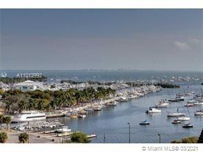 Spectacular views from this stunning 2 bed 2 bath unit impeccably renovated with expansive terraces, living spaces and closets. The building's amenities include  24 hour security, heated pool, tennis court, valet, concierge, library and recreation room  All this just blocks from Coconut Grove Village, restaurants, shops and marina.
