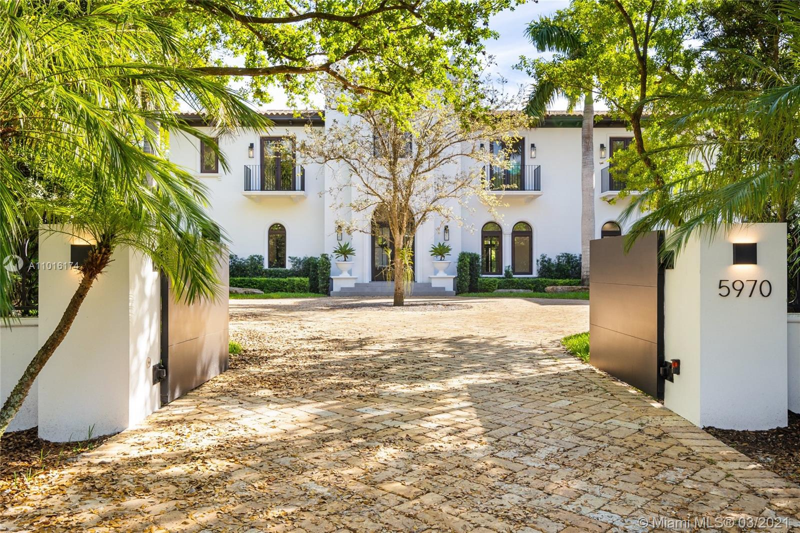 Completely renovated in 2020, this timeless estate is the epitome of Miami lifestyle. Enter through the dramatic foyer and fall in love with the curved staircase and rustic wood beamed ceiling. Designed by Ramon Pacheco with a Modern & traditional blend made to seamlessly enhance visual impact throughout. Architecturally-rich home has 9,848 total sq/ft with 7BD/7.5BA on a private builder's acre with majestic oaks. The kitchen is an epicurean dream with Wolf/Sub Zero appliances & floor to ceiling stained oak cabinets. Open family room with built-in custom bar. Grand 1st floor master suite with stunning bathroom. Smart home with Control 4 automated system. Built 15.2' above sea level with impact resistant windows/doors to insure you'll be prepared for any climate! Wine cellar and elevator.