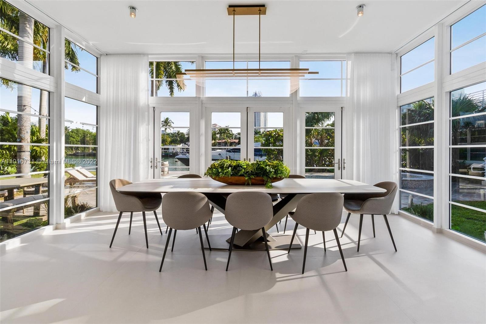 Sitting on most prestigious and in demand location of Miami Beach, this immaculate estate offers 140' of open water on Indian Creek.  Renovated with modern tastes and originally designed by architect Igor Polevitzky, this prestigious estate has been entirely renovated to offer only the finest finishes in interior design and state of the art appliances.  Large living areas, three-bedroom guesthouse, summer kitchen, and fully equipped for your leisure with sauna room and heated pool.  Location, location, location.