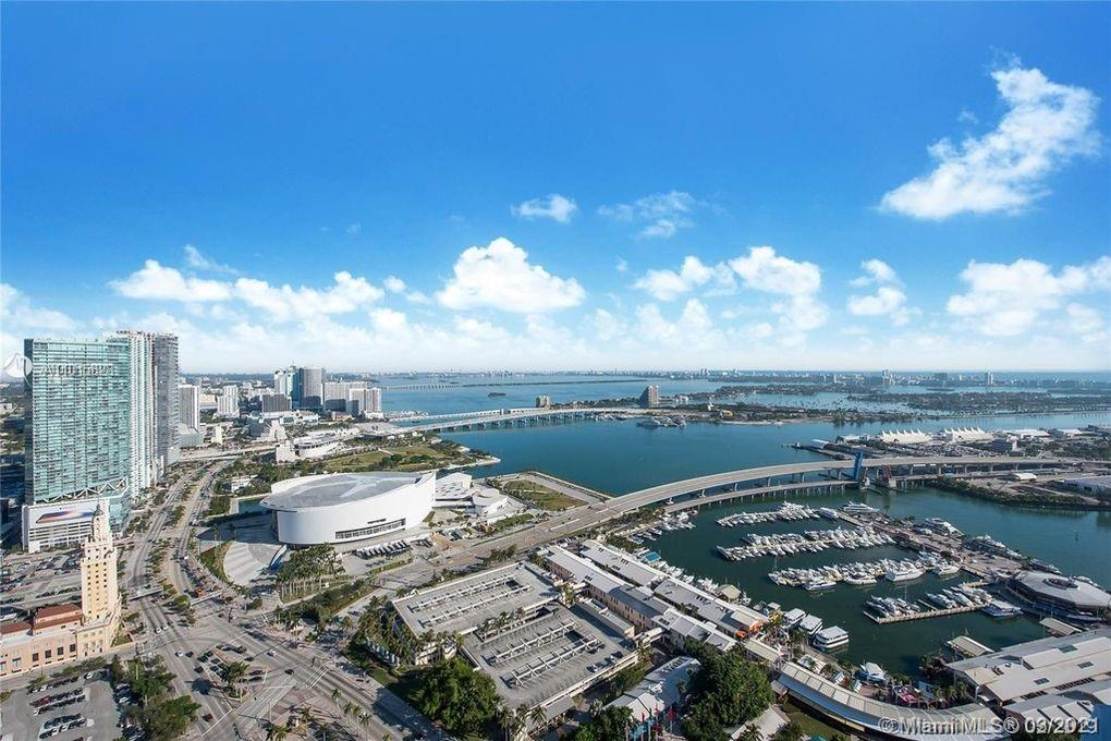 Imagine a unique 2 story PH w/ 1700 SF of outdoor rooftop patio & 2 other private balconies on the 49-50th floors, with EXQUISITE 5 STAR LIVING, in Downtown's finest resort style condo! This spacious 3 beds & 3.5 baths has panoramic views of Biscayne Bay, the beaches & the Miami skyline. Live the Miami dream w/ feat. incl. a private master suite w/ panoramic views & private balconies, floor to ceiling windows, tile floors, modern open kitchen w/ SS appliances, designer bathrooms, custom lighting, 3 PARKING SPACES + much more! Welcome to the most luxurious home in the skies! Luxury amenities incl. 4 pools, gym, clubhouse, bar, spa & sauna, movie theater, concierge services + doorman & security. Within walking distance to all the entertainment Downtown Miami has to offer. A TRUE MASTERPIECE!