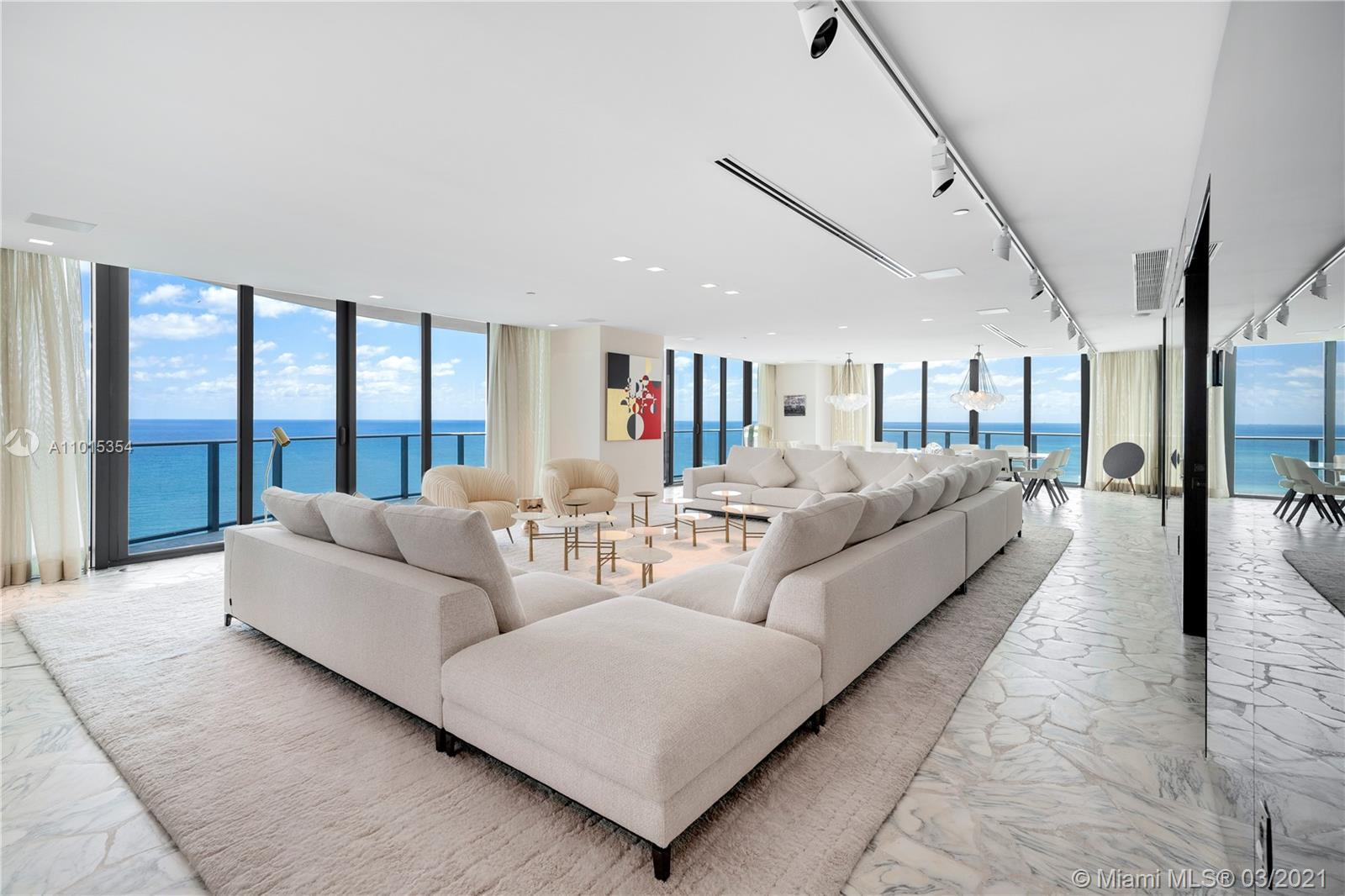 Enjoy 360 degrees of unobstructed views. This 4,992 square foot marvel in the sky boasts Atlantic Ocean and sunrise and sunset views that will take your breath away. With only one residence per floor a wraparound balcony spans the entire 17th floor while 4 BR, 5+1BA, a custom gourmet kitchen and an open floorplan living and dining room area exude luxury in every corner. The living spaces feature seamless 10 ft floor-to-ceiling glass walls & sensational views of the Atlantic Ocean, Golden Beach, & skylines of Miami. Every room offers views and balcony access while the principal suite boasts dual rain showers, sinks and closets. Regalia offers a concierge, full service spa, beach & pool, a private wine vault, business center, children's play room, library, yoga studio & fitness center.