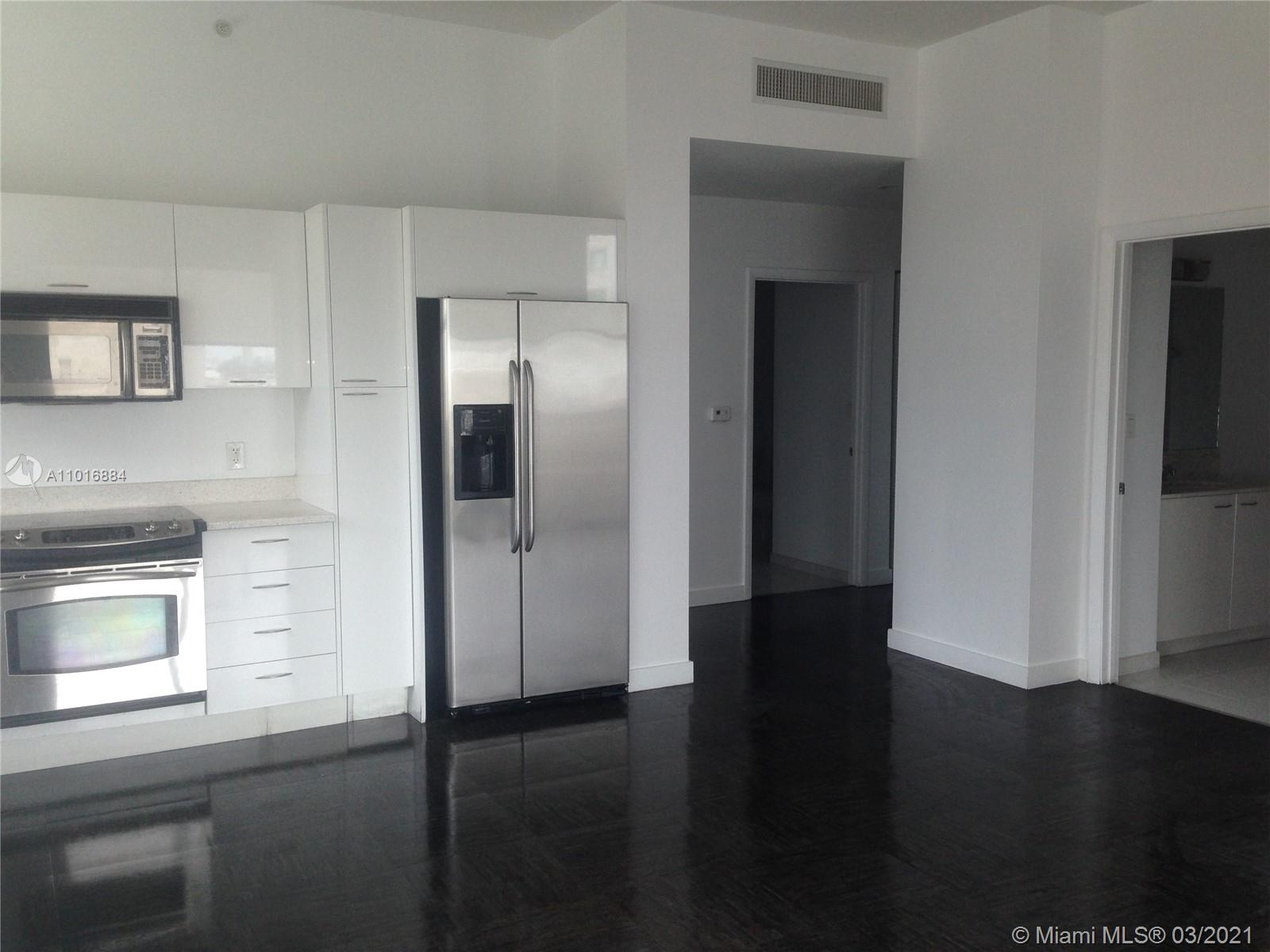 Extended Balcony!!Best line in the building. Tiled floors inside and out. Stucco and painted ceiling. Great investment property in thriving Downtown Miami.