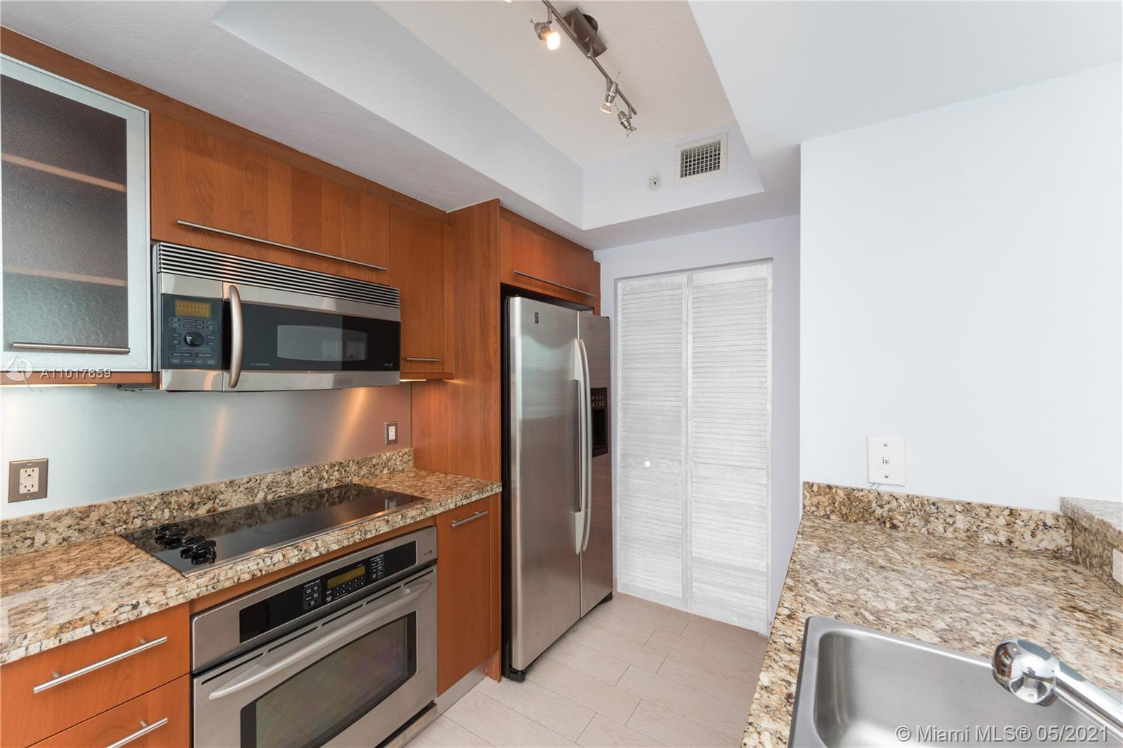 Located in the coveted South of fifth neighborhood, this unit features an open kitchen to the living room, granite counters, Italian fixtures, SS appliances, and a balcony overlooking the newly upgraded tropical landscaping and green wall. The Cosmopolitan is a full service building with 24/7 security, heated pool w/Jacuzzi, fitness center, & club-room. Walk 2 blocks to the beach, fine dining, & South Pointe Park. Building is financially secure.