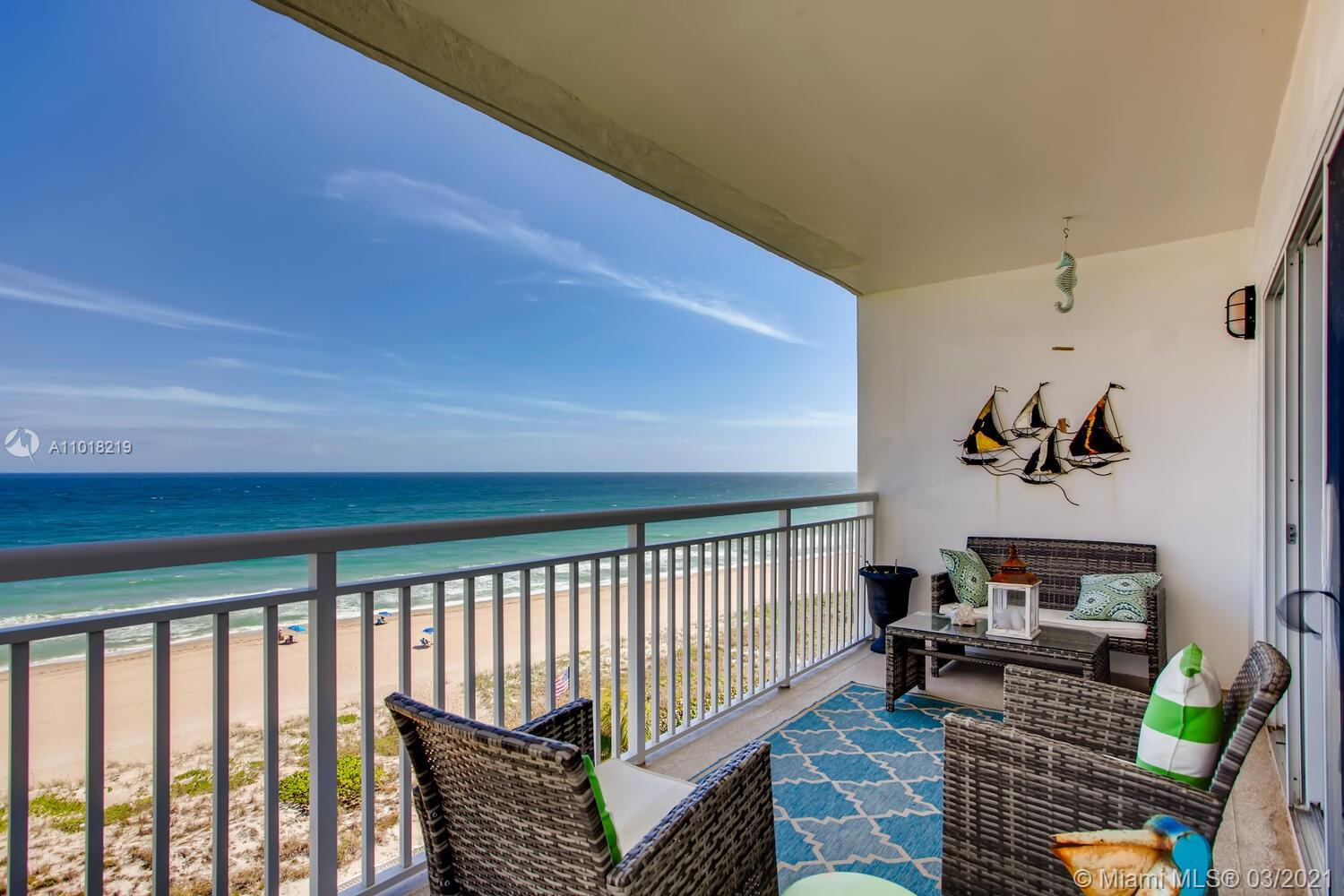 Beachfront condo with unrestricted ocean views! This bright and airy 2 bd / 2 ba unit awaits you with a private balcony, sizable bedrooms, and an abundance of natural light. Open air walkway to the unit, where upon entrance you're greeted by tile flooring and a kitchen off the foyer, equipped with white cabinets and appliances, recessed lighting, and a pass through window into the open dining and living room. Open up the sliding glass doors to feel the ocean breeze and enjoy an indoor/outdoor living space overlooking the water! The views continue into the primary suite, complete with cozy carpet flooring, a modern ceiling fan, and a bath, featuring a white vanity and tiled glass door shower. Accommodate guests in the second bedroom, which has easy access to the full hallway bath.
