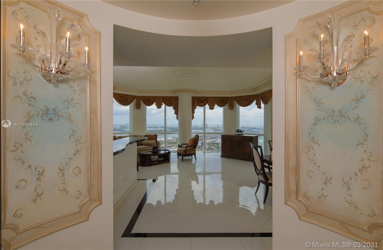 Unobstructed 180 water views, spectacular bay + ocean views, 2 balconies, ceiling to floor glass, decorator finished, luxury finishes in the heart of Miami across from Bayside, granite countertops, stainless steel appliances, luxurious walk in closets, all marble floors, electric shades, chandeliers, 4 pools, fitness center, Jacuzzi bar, sauna, steam, valet.