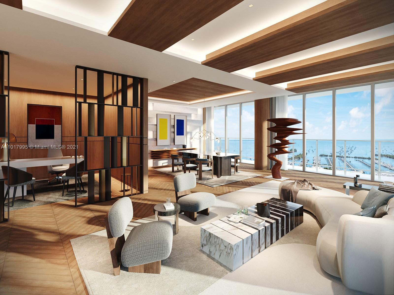 This full-floor penthouse at Grove at Grand Bay has been conceptualized by Tamara Feldman Design to instill depth and character to this architectural marvel by Bjarke Ingels which twists exotically on the Coconut Grove skyline. Spanning 10,118 square feet of interior space, the proposed design combines various natural elements such as herringbone floors and wood veneer ceilings with cove lighting in the living room and illuminated limestone in the dining room, with oversized bronze doors leading to the office. Under the 12-foot ceilings, the hurricane impact glass walls offer spectacular views of the Coconut Grove waterfront, enveloped by long, deep balconies. Meanwhile, one floor up, an exquisite private roof deck with an oversized pool is your arcadian oasis.
