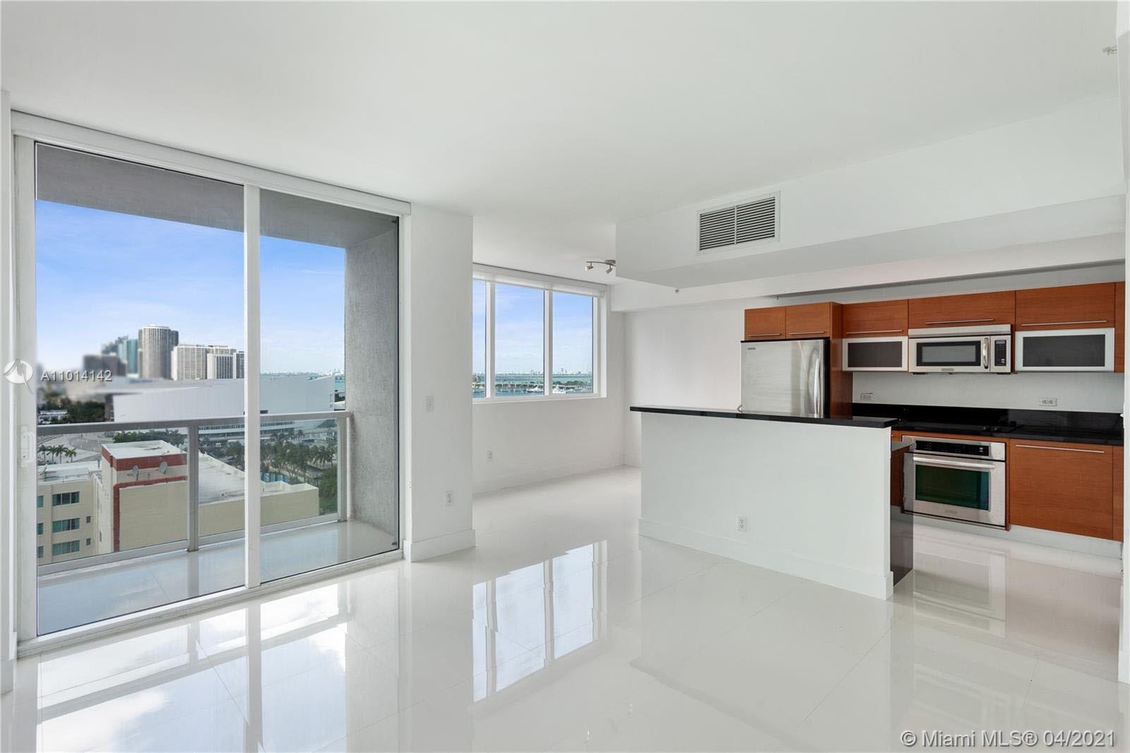 WOW SEE THAT VIEW!!  from this 1 bedroom + enclosed den and 2 full baths. Great location in downtown Miami. Remodeled with porcelain white floors thru-out, modern appliances, high impact windows, W/D inside unit, walk-in closet, Stainless Steel appliances in the kitchen. Private parking. Luxury building with 5 star amenities: Jacuzzi, sauna, pool, theater, bar, lounge, conf. room & more.
