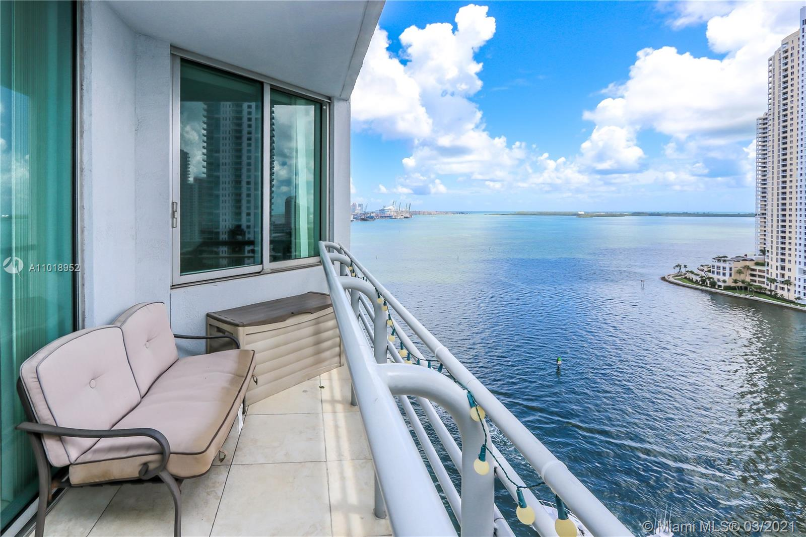 Beautifully split plan 2 bedrooms 2 baths condo with direct views of Biscayne Bay, Miami River and Brickell Skyline. Unit comes with Italian kitchen cabinets and granite countertops and marble baths. Building amenities includes: 2 swimming pools, jacuzzi, 2 party rooms, 2 fitness centers, convenience store, 24 hours security, valet and concierge. Centrally located within minutes to SoBe, Grove, Gables, and Design District. Sales Office in bldg.