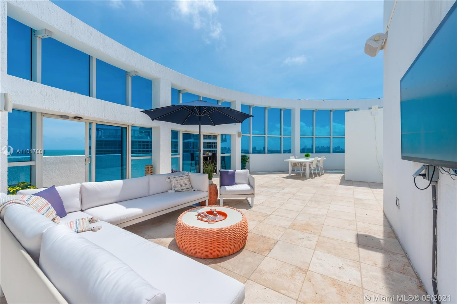 Impeccable corner 4 bedroom, 4 bathroom rare penthouse gem at the Mosaic in Miami Beach. Watch the sunrise and sunset from your private rooftop and 4 balconies, featuring stunning ocean, intracoastal and city views. The rooftop terrace is very spacious for entertaining and overlooks the entire city. A private foyer entrance leads to an open living space with an abundance of natural light. This large furnished unit boasts a split floor plan with a den/family room and 3 assigned parking spaces. The Mosaic offers wonderful amenities- a heated pool, beach service, gym, complimentary valet, front desk attendant, lobby secured, and management on site.