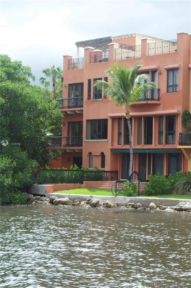 Gated Townhouse community on the water with guard house, 4 bedroom 4 1/2 bath, 5200+ sqft, waterfront unit, grass yard, 2 car garage w/Tesla charging plus covered carport for 2 more cars, 2800 bottle wine cellar, elevator (4 stories), electric blackout shades in living room.