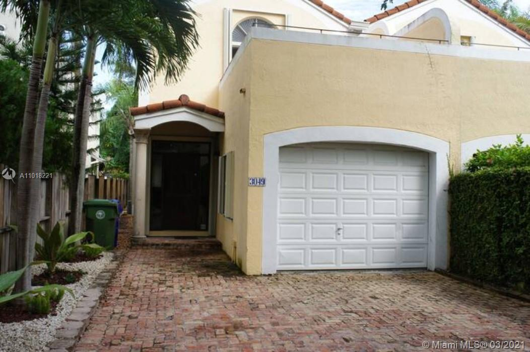 This townhome is a gem in The Grove, with marble and wood floors, huge master room with large walk-in closet, open living area, stainless steel appliances, granite countertops, gas range. Private pool with covered porch. The property is completely fenced. There is no maintenance fee or association dues. Great for people that work from home. This is a Beautiful Miami Home!  Occupied by tenant, contract expires in November 30,2021