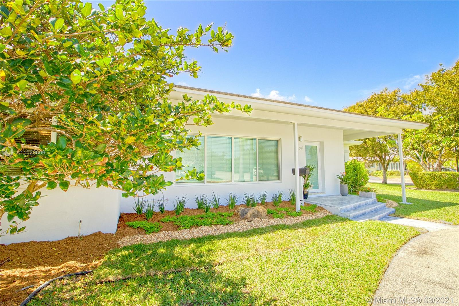 Welcome inside the gated island of Normandy Shores and live in this updated, mid-century modern Miami Beach home. With over 3,000 SF of bright living space, the house has a wide open-floor plan with warm hardwood floors and expansive windows. This family-friendly home bares 4 large bedrooms, including a master suite on one side of the house and second master suite which also doubles as an office. All 3 bathrooms are updated and spa-inspired. Walk in closets in both master suites. Enjoy a spacious white gourmet kitchen. Easy to add outdoor living space. The island is pedestrian-friendly and walking distance to amenities, including an 18-hole PGA golf course, 4 spectacular tennis courts, clubhouse with bar/outdoor restaurant, outdoor gym, playground, basketball courts and soccer field.