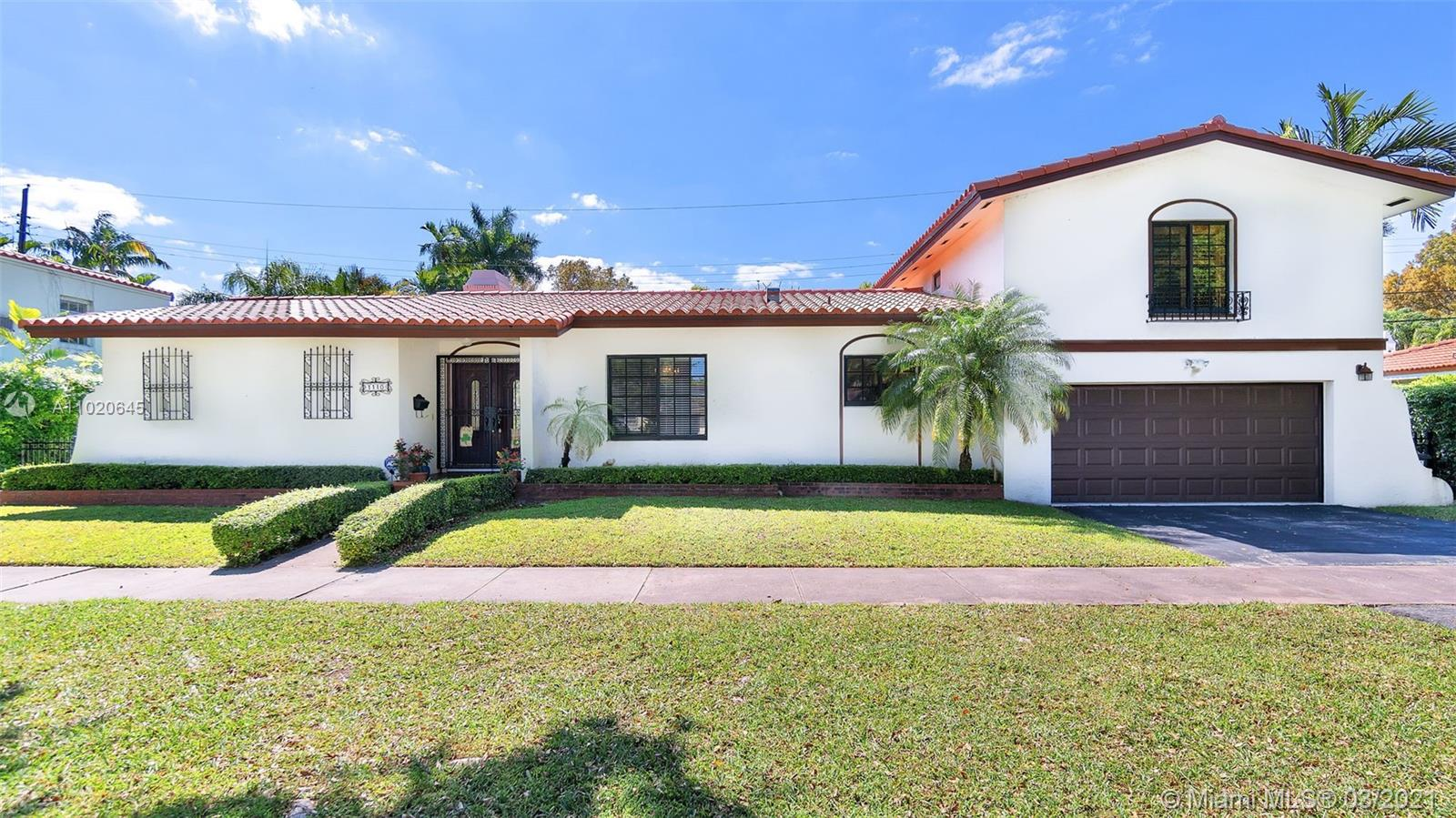 """NEW ROOF & HURRICANE IMPACT WINDOWS. A must see beautiful home on the prestigious and sought after Granada Boulevard. Classically remodeled, Mediterranean style 3/2.5 in the heart of """"the city beautiful"""" Coral Gables. Boasting over 2,500 SF of living area, this classic Coral Gables home offers a beautiful & bright Florida room, large family room, large classic living room w/ wood beam ceiling and fireplace to match, as well as large remodeled kitchen and formal dining room. Downstairs master suite with bay window, separate from the other two large bedrooms. Large 2 car garage. Professionally installed turf patio. Impact windows and doors throughout the house. New Spanish tile roof, new washer/dryer, new water heater. Walking distance to Granada Golf course and Coral Gables Country Club."""