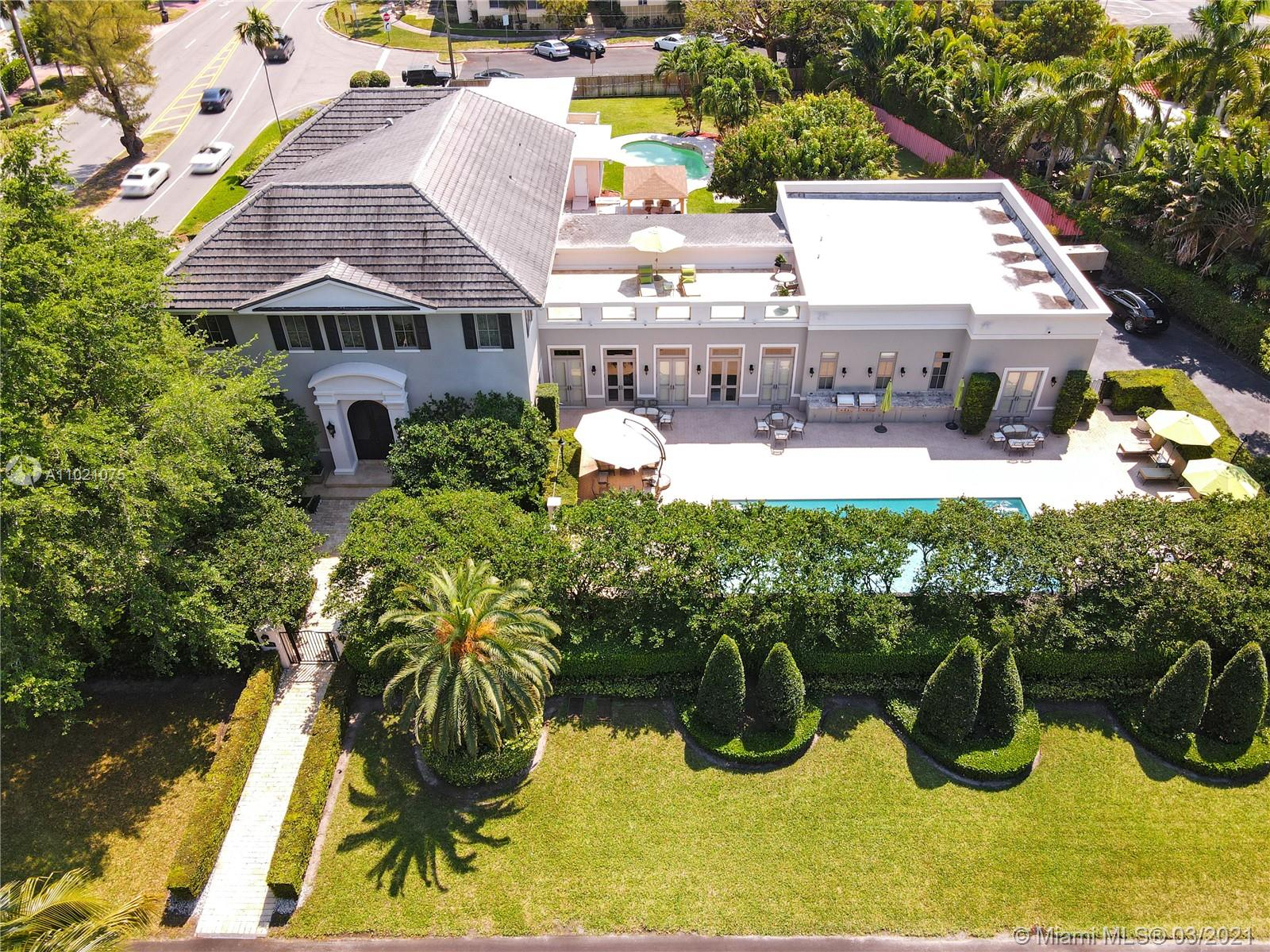 7 Bedroom 5.5 Bath elegant French neoclassical masterpiece by noted architect Jorge Hernandez. Enter through your beautiful intimate French garden on quiet 31st Street. Tall doors with transoms, 12 in. baseboards, fabulous crown moldings and features throughout. Impact windows and doors & full home generator plus elevator. Open 12 1/2 ft ceilings on main level. State-of-art kitchen within spacious family/ great room and extra-large living areas. Main suite with grand oversized walk-in closet. Private rooftop deck perfect for entertaining. Heated oversized 40x18' pool, 2 outdoor barbeques & grill. House is elevated 3 ft above ground level. Lighting fixtures are not included. Truly one-of-a kind! A must see!