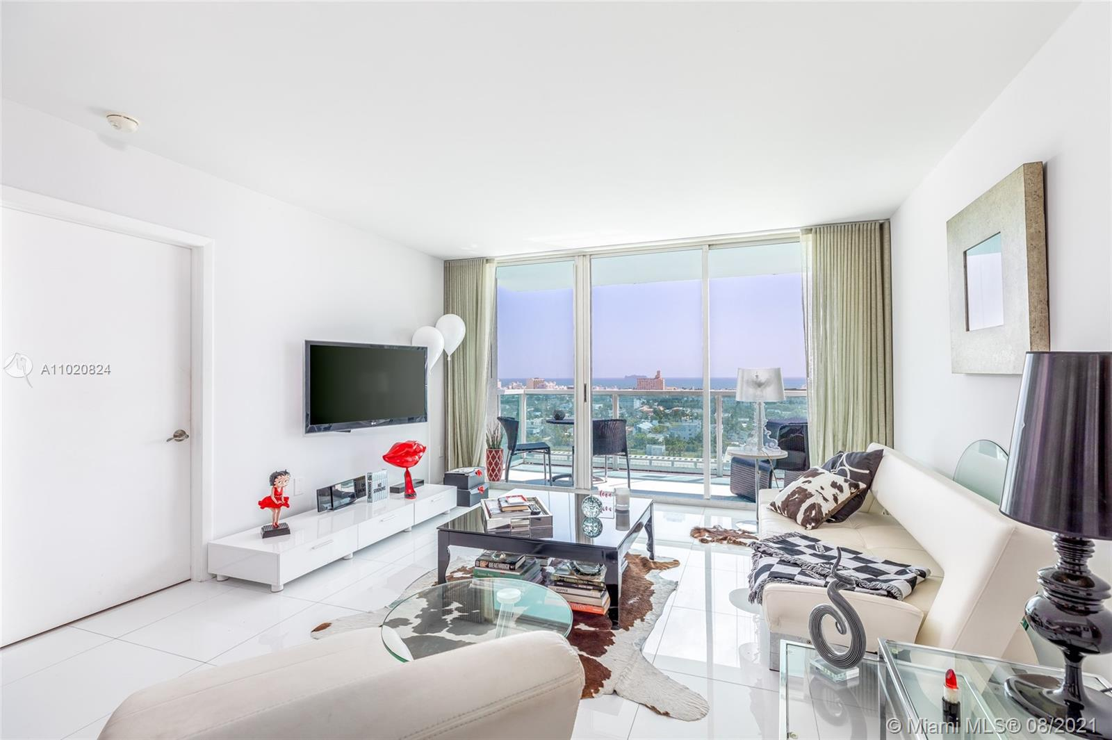 Wake up to the views of the Ocean and Miami Beach from this renovated 2 bed 2 bath condo filled with sunlight. Split floor plan, spacious, large porcelain tile throughout , Kitchen partially open to the living room with quartz countertops, stainless steel appliances and Washer and dryer in unit. Modern bathrooms with enclosed shower and bath tub. Master bedroom features a large walk in closet and dressing area. The Floridian is bay front building conveniently located on West Ave, just minutes away to beach, grocery stores and entertainment, it offers vast array of amenities including 2 pools, spa, boat docks, full gym, tennis court, business center, concierge, 24 hour security and covered secure parking.