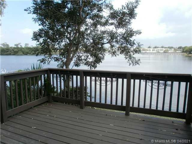 Gorgeous lake front townhome with 3 bedroom & 2.5 bath in a gated community. Enjoy beautiful lake view in a large deck and our master bedroom balcony. Updated kitchen and renovated bathrooms with vanity. Brand new Laminate floors upstairs. Fresh paint in living room and Kitchen. Brand New Dish Washer. Large and open living room. Spacious walk in closets. Tile downstairs and Laminate upstairs. Two parking spaces. New Accordion shutters. Quiet and safe gate community. Walk to pool. Spacious community pool on the lake. Close to highway, beaches and shopping centers.  Pet deposit #300/pet, first & last month & security deposit. HOA required credit score 650+ and a minimum of one year employment with same employer.