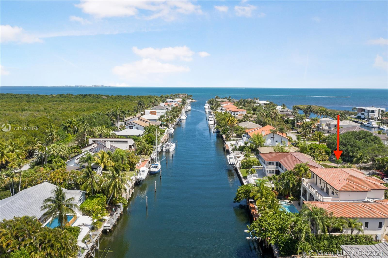 """Welcome to Boater's Paradise! This elegant waterfront home in the exclusive """"Gables by the Sea"""" gated community will bring you peace, serenity and wonderful outdoor living space that will feel like a vacation every day.  Enjoy a relaxing boating lifestyle with a 75-foot private dock and a boat lift NO bridges just a few minutes sailing to Biscayne Bay. This is an ultimate endless entertainment home with a Pool/Spa, BBQ area and Game/TV rooms surround by a well-manicured landscape yard. The home features the highest quality of marble finishes and hardwood floors, hurricane impact windows and doors and a complete video surveillance system. Spacious floor plans with 5 beds + 6.5 baths and a plenty of storage. Close proximity to best public and private schools, parks, restaurants and malls."""