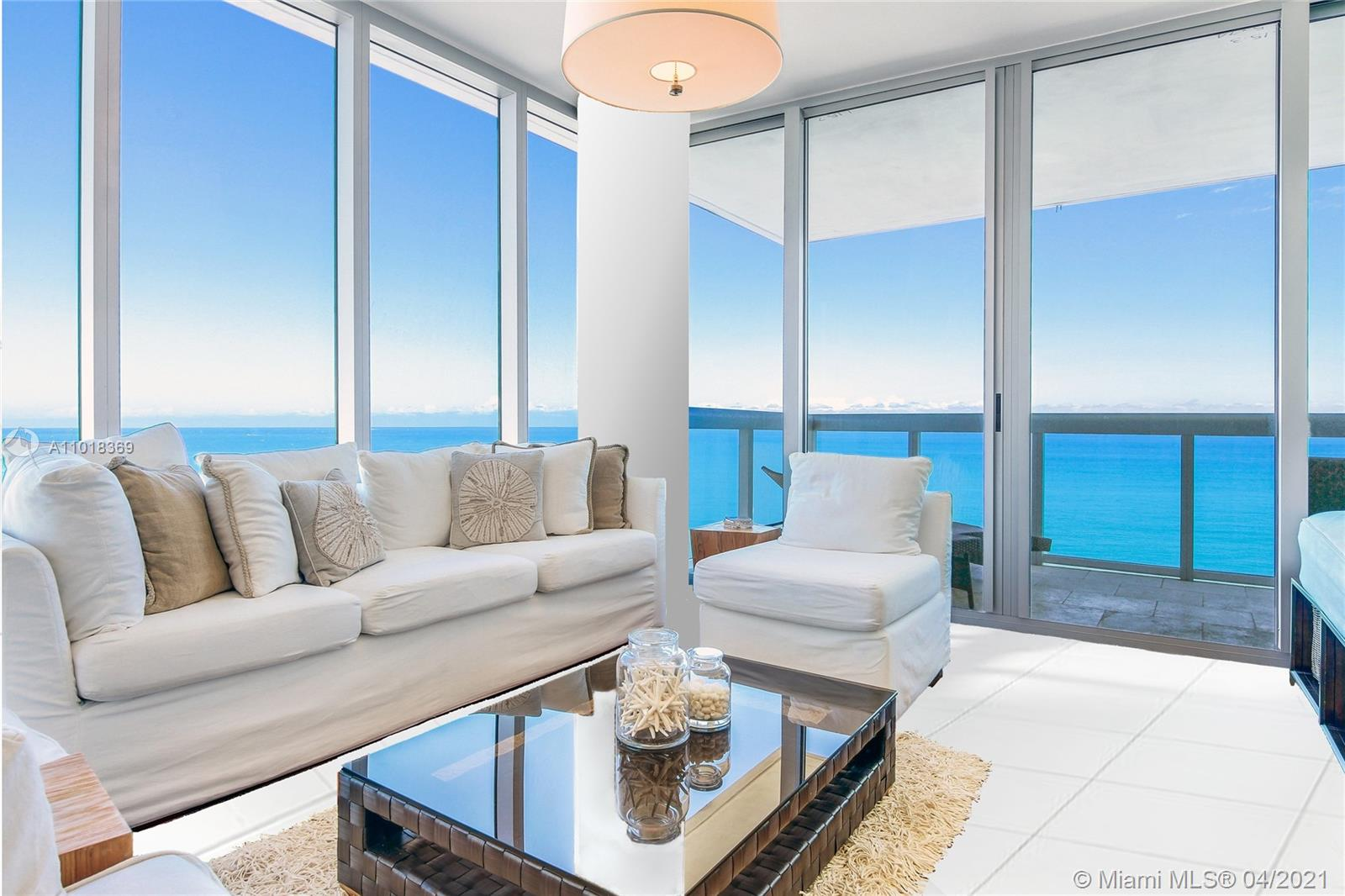 Most desirable line at Carillon in the exclusive North Tower Residences. This N.E. corner unit features floor to ceiling windows, white tile floors throughout and an expansive ultra private balcony with ocean views from every room.  Breathtaking, unfurnished 2 bedroom / 2 bathroom beach house will not last! Carillon lifestyle is unsurpassed, residency includes (8 person) access to Carillon Resort's exclusive services + amenities which has been voted as a #1 Resort in Florida. Five star amenities w/ 4 gorgeous pools, private beach service/attendants, salon, indoor rock climbing, & a 70,000-sqft spa & wellness facility offering 100+ classes/week in yoga, Zumba, spin, etc., Organic Restaurant & café onsite. Please note, some decorative features may differ slightly from the pictures.