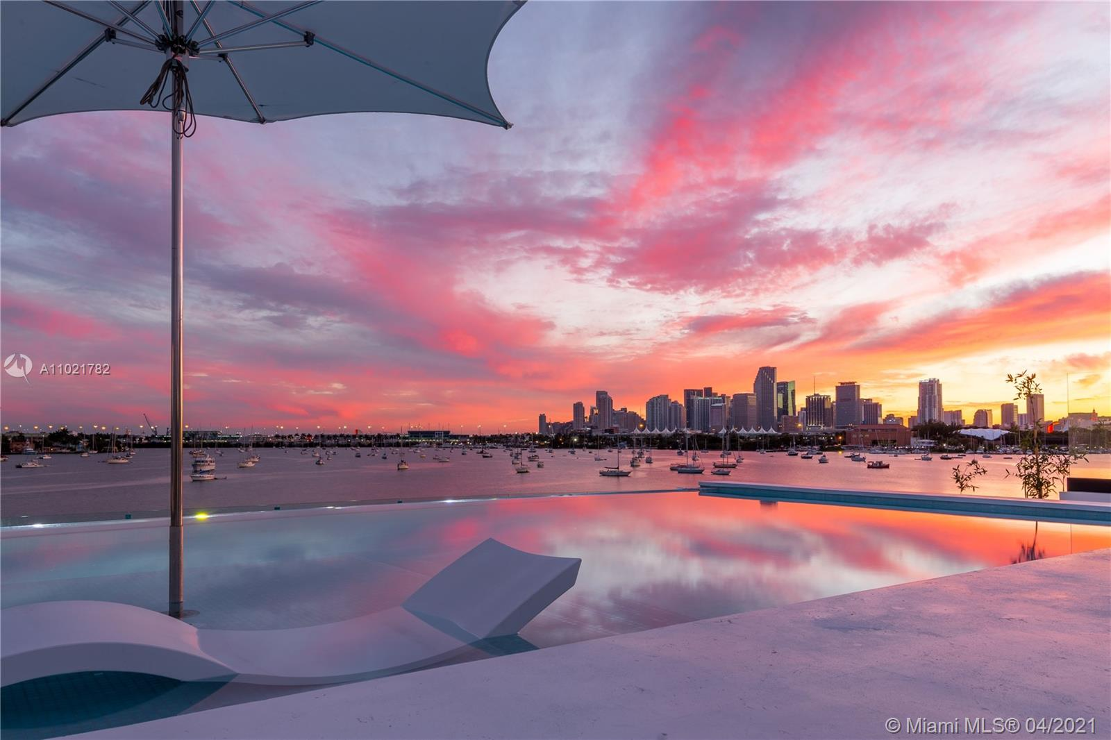 """Welcome to Villa Venetian, the most spectacular Bayfront Villa located on the Venetian Islands. With rarely available Southern exposure, the Villa has unparalleled views of Biscayne Bay and the Miami skyline. This """"smart home"""" completed in 2015 is fully automated with a Savant system that operates everything from custom lighting, and automatic shades to music and television. Sophisticated European design featuring white oak floors, soaring ceilings, one of a kind rooftop infinity pool, expansive terrace with 360 degree views, home theater, elevator, and sauna are just a few of the unique features of this home. Exclusive and convenient location just minutes from Sunset Harbour and Lincoln Rd and a short distance to Downtown Miami, Brickell, and the Design District."""