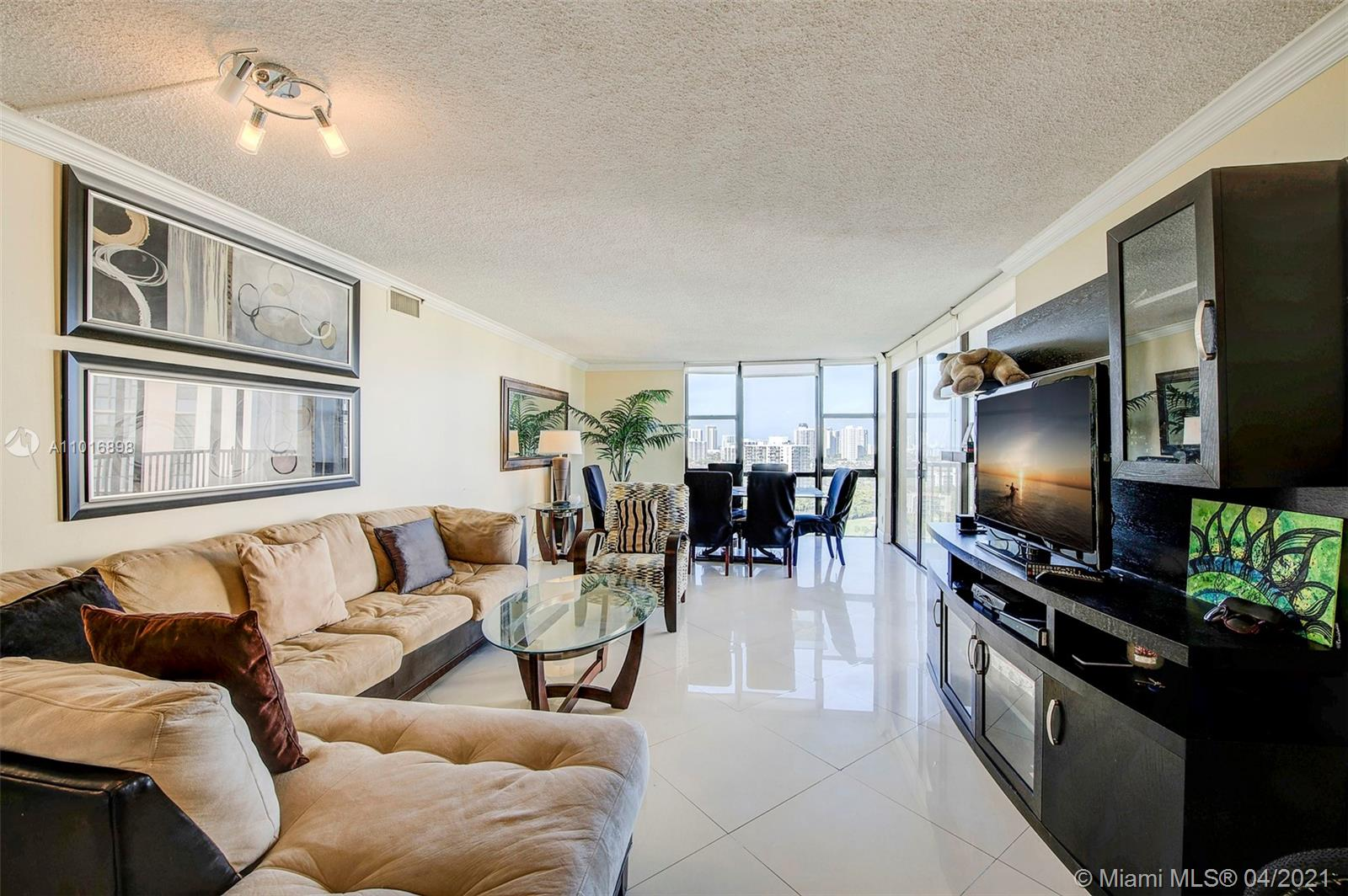 This large two bedroom, two bath condo on the 20th floor with over 1,300 sf of living space is completely furnished and offers beautiful views from the top, the coastline to the east and the golf course. The Coronado Buildings are located in Aventura, close to Turnberry Golf Course and Aventura Mall, and many restaurants and shops.  The building has recently renovated the floor hallways and it looks amazing.  A new assessment begun February 2021 (only $140.00 month) which will continue to beautify this community and bring the property values only upward.  Bike storage, doggy park, large pool, sauna, gym, library, etc. The monthly maintenance includes water, cable and internet, gated entrance and security.