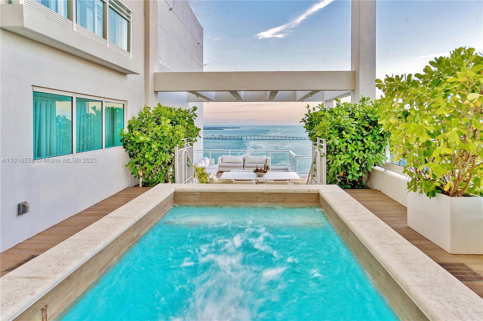 PENTHOUSE FOUR (Top 3 Floors) at Asia on Brickell Key w/ $450K of designer furnishings from Artefacto. Your Tri-level Dream PENTHOUSE at Asia, the Island's Premier Luxury Building, has over 7,300 SQFT of (interior 5,359 / exterior 1,946) living space w/ soaring high ceilings, a Gourmet Kitchen, European Oak Wood Floors, a Secluded Top Floor Master Suite, 4 Premium Parking Spaces, a Private Fingerprint Elevator to the unit & an Interior Elevator. Your HOME IN THE SKY has 270 degree breathtaking Bay, Brickell, Downtown & the Ocean views from Seven Terraces, one which features a Private Rooftop Pool & Wet Bar. Live on an exclusive Island Oasis w/ parks, the 5 Star Mandarin Oriental, a Marketplace, Restaurants, & is steps away from Miami's Brickell/Downtown Financial & Entertainment District.