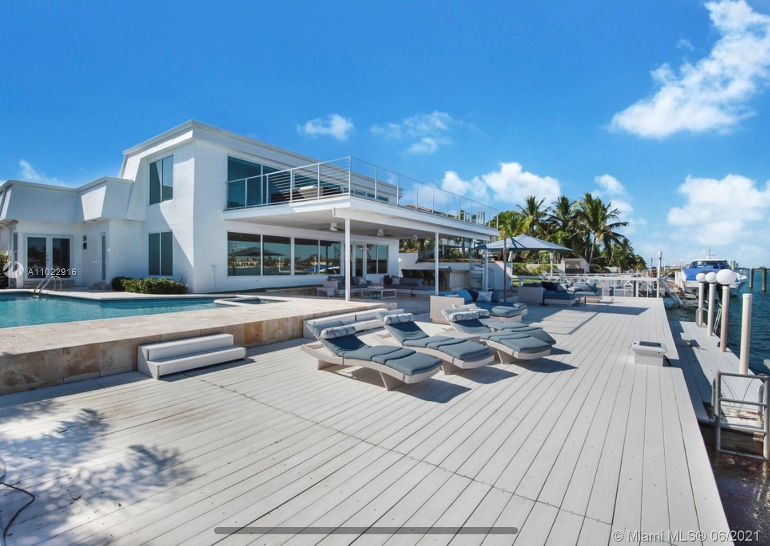 Welcome to 1055 Stillwater Drive. Miami Beach's best-kept secret, and visit this 7 bedrooms 5 bathrooms waterfront home sitting on a large 11764 Sq. Ft lot. a luxurious guard-gated Island in Miami Beach. You'll be in love with the panoramic open bay view. This beautiful home boasts 78 FT water frontage. Bring your boat, jet ski, kayaks and enjoy the waterfront Miami Beach lifestyle. This spacious two-story home features two master suites, a private one on the second floor with an extra-large porch to enjoy breathtaking views of Indian Creek, Biscayne Bay, and Surfside Skyline. Watch the dolphins and the manatees right at your feet. The outdoor porch offers spacious sitting and lounge areas some of them nicely covered to enjoy this lifestyle during summer and winter days.