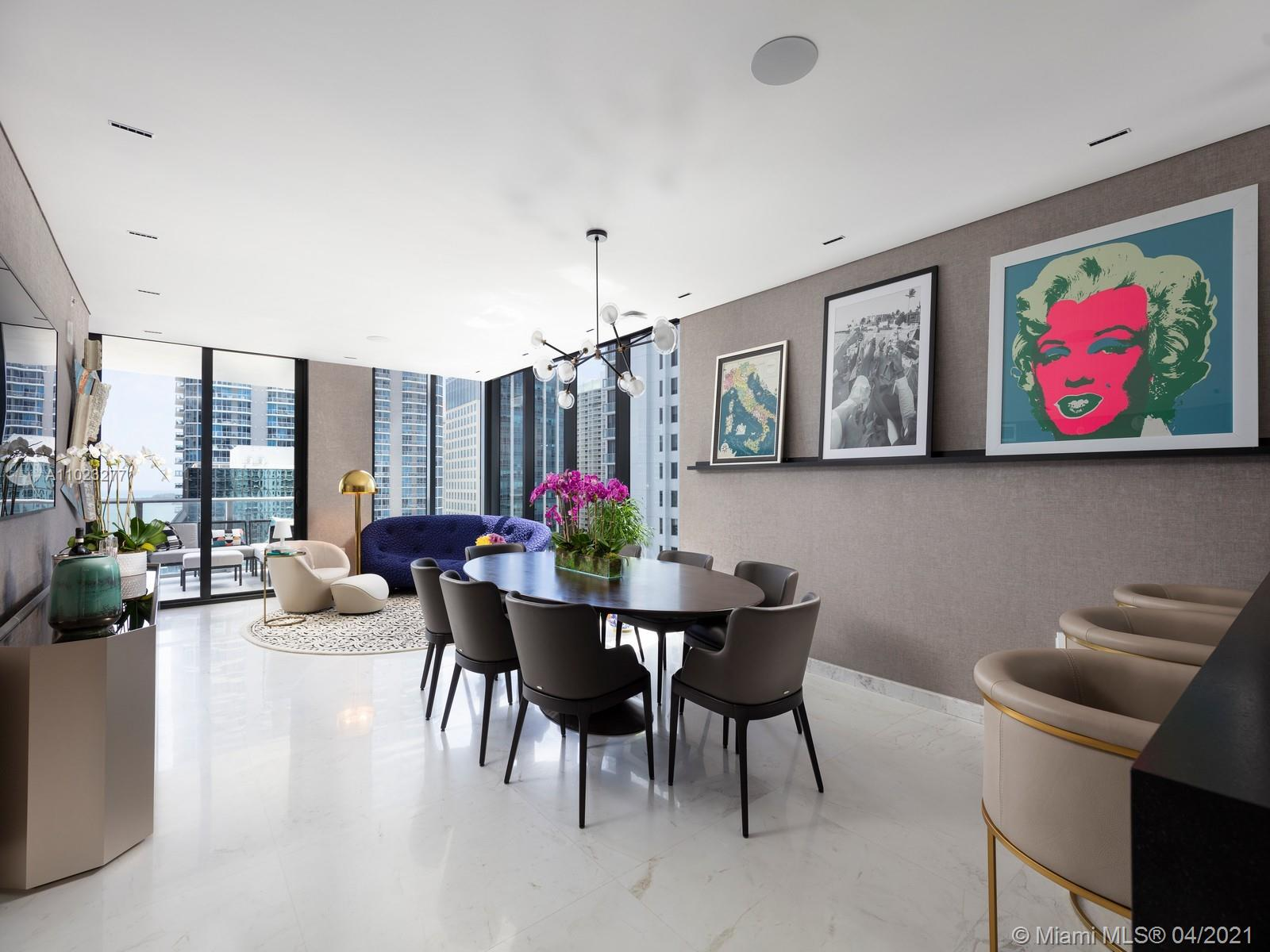 Welcome to The Trophy Unit of 1010 Brickell. With 3 beds + Den & 3 baths, this unique corner unit was completely upgraded, unlike any other unit in the building. Private elevator takes you into a spacious Den w/a custom built-in bar between the Den & upgraded Kitchen, which was completely redone by Italkraft w/custom appliance wood millwork. Drop down ceiling in Living Room & Den, including dimmable lighting and surround sound speakers throughout the unit. Smart home system to control lights, speakers, blinds, and AC from your phone. Enjoy your balcony w/an electric BBQ and stunning water and city views. Building amenities: 2 pools (Heated & Rooftop), Basketball, Squash, Arcade, Jog Track, Gym, Spa, Social Room, Theatre & Business Center. Unit next door, #2404, also available for sale.