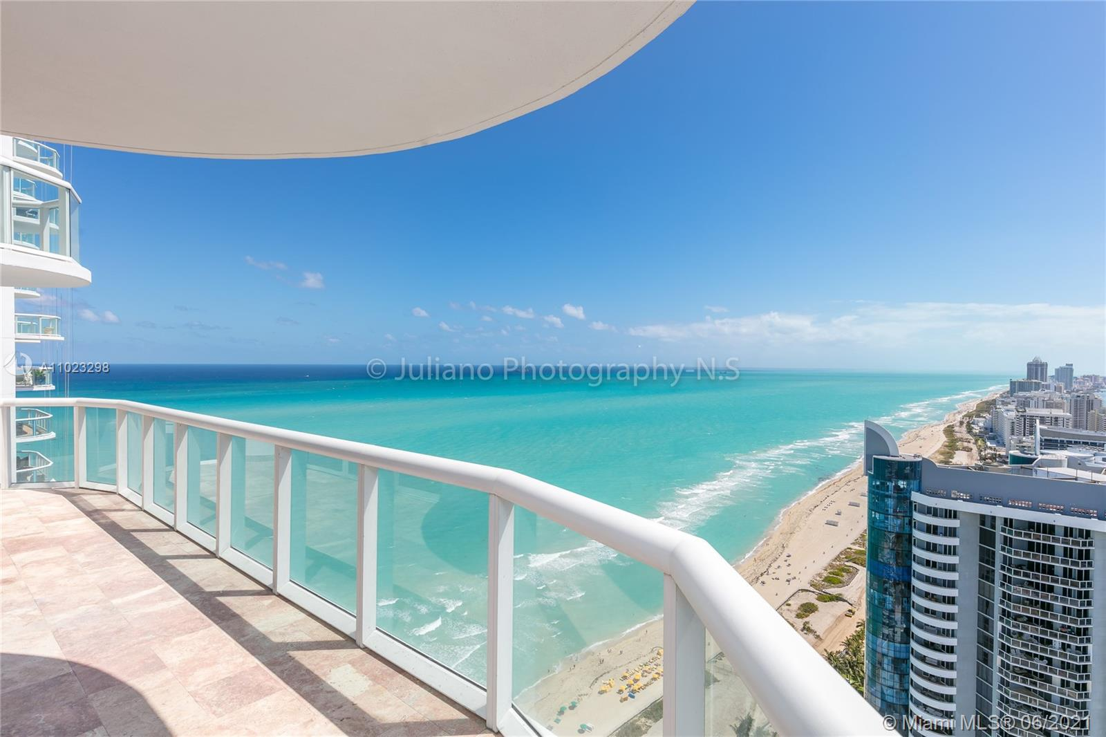 Breathtaking unobstructed views from the 41st floor!!! Floor to ceiling sliding glass doors and windows in every room for easy access to the balcony and to enjoy views of the downtown skyline, Biscayne Bay, and the Atlantic ocean. Beachfront condo with direct access to the beach. Immaculate marble flooring throughout the living and dining area and wood flooring in the bedrooms to keep your feet warm. The kitchen is equipped with top-of-the-line stainless steel appliances and the master bath features a jacuzzi with separate shower and double vanity. Building amenities include a gym, sauna, steam room, heated pool, tennis court, beach service, attended lobby, 24-hour valet parking, and much more! A Must see!
