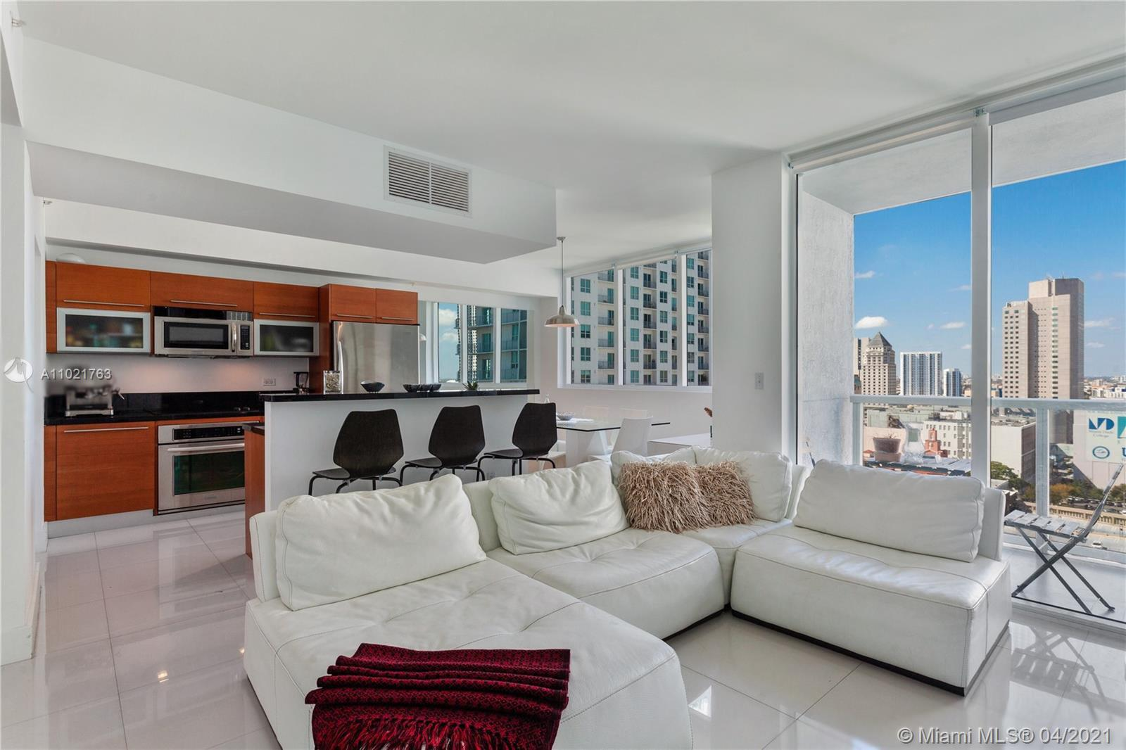 Large 1 bedroom + Den converted into a 2 bedrooms 2 baths. Corner unit in the Heart of Downtown Miami. Unit has tile floor and in well kept condition. Building offers resort like amenities with gym, heated pool, and much more. Great location for those looking to take profit of public transportation. Easy to show, 24hs app.