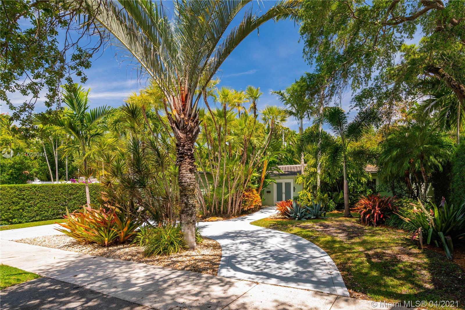 Nestled into this great Coconut Grove spot in Bay Heights, this home is a tropical delight. Open and airy with bragging rights that include a newer roof, impact glass, new floors, and new bathrooms. A spacious family room with wood beam ceilings compliments the open living and dining room as well as overlooking a beautifully landscaped backyard and glamorous pool. The eat-in kitchen has granite countertops, wood cabinetry and stainless-steel appliances. Bay Heights has 24-hour roving security and is conveniently located near Key Biscayne, Brickell Avenue, Vizcaya, Mercy Hospital, the Village of Coconut Grove and expressways.  A Very Special Home.