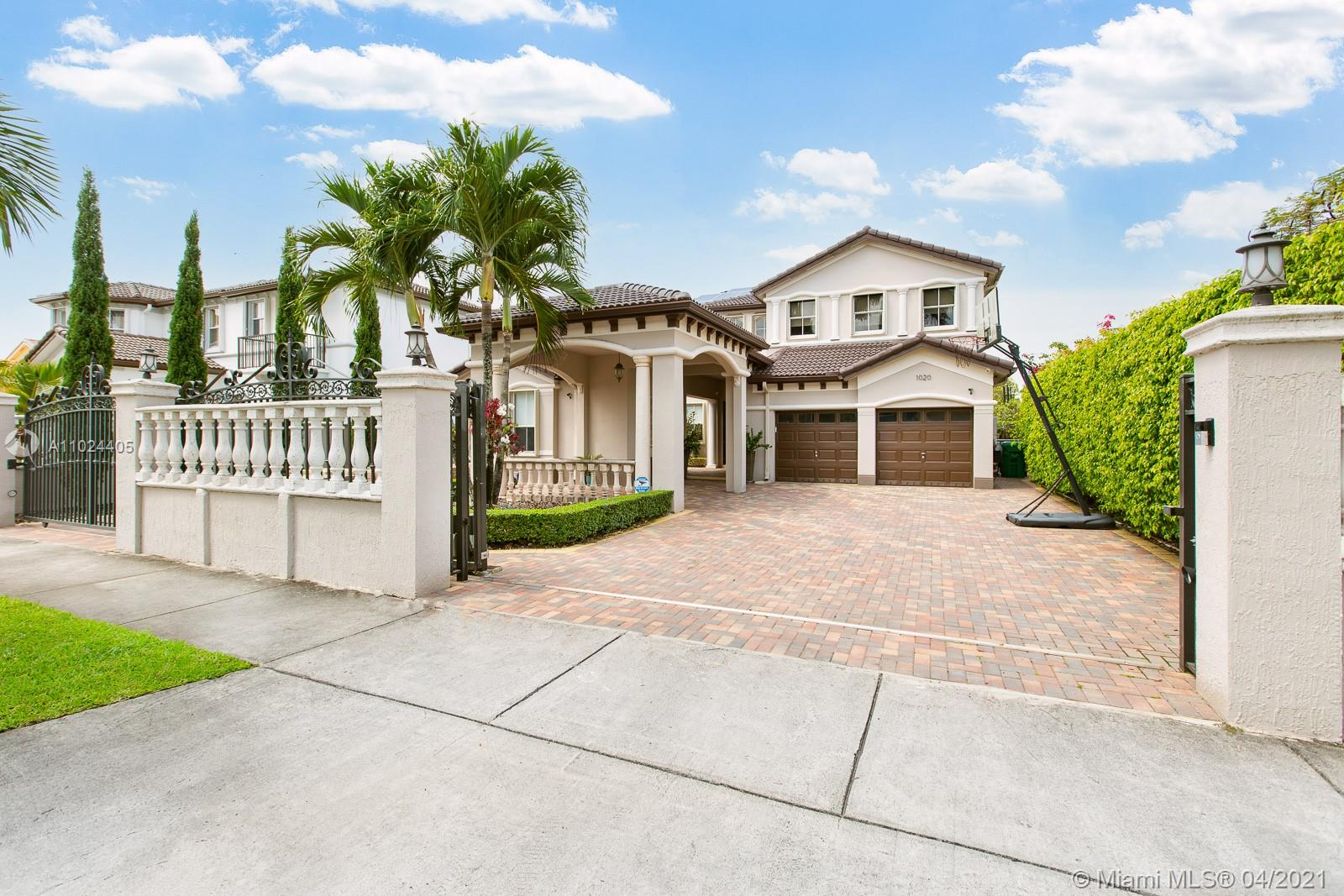 Splendid Grand Lakes one of a kind 4bed/3.5bath/2car garage+porte cochere/gated LAKEFRONT pool home has been remodeled w/ top quality finishes. This fine home offers separate 1bed/1bath guest quarters w/ courtyard that can serve as office,bedrm,exercise rm etc. Main home offers 3bed+2.5baths w/ new modern white kitchen cabs+quartz tops+center island open to spacious fam room, high ceilings living area & custom glass staircase railings. Master suite offers balcony w/ lake view, large his/hers walk-in closets, & large updated master bath a must see! Energy efficient home has solar panels for reduced utility bills & accordion shutters for all openings.  All pavered exterior areas w/ refinished pool/spa+new equipment. Exterior BBQ cooking area by lake. Come Home to Grand Lakes & Live Well!